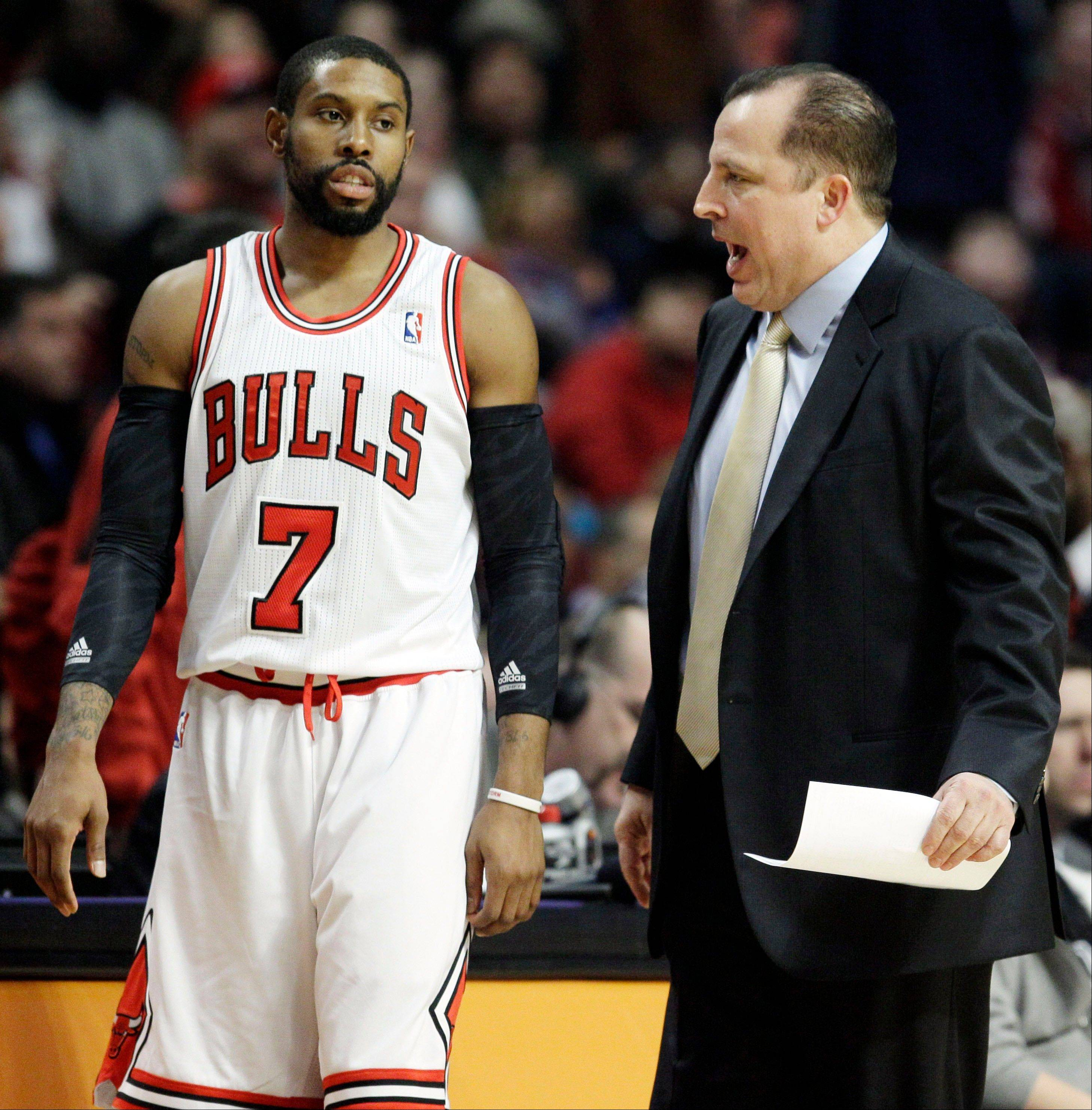 Chicago Bulls head coach Tom Thibodeau, right, talks to C.J. Watson (7) during the first quarter of an NBA basketball game against the Milwaukee Bucks in Chicago on Friday, Jan. 27, 2012.