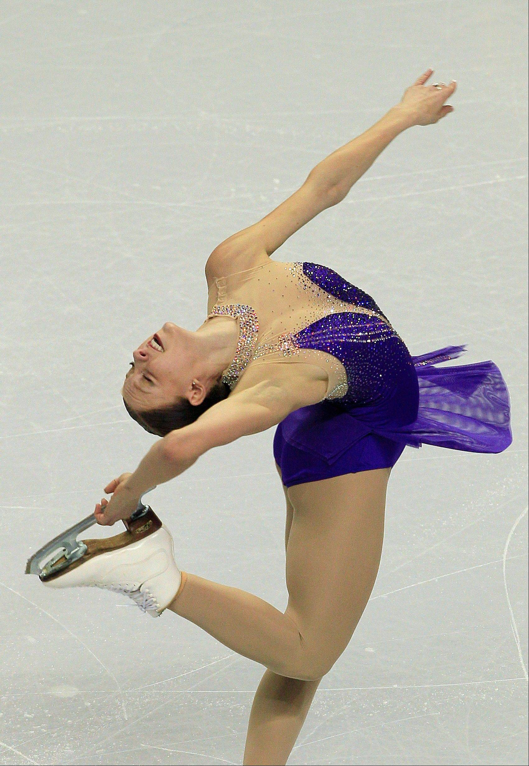 Skating to a blues medley, Agnes Zawadzki of Des Plaines captured the lead in the ladies short program competition Thursday at the U.S. Figure Skating Championships in San Jose, Calif.