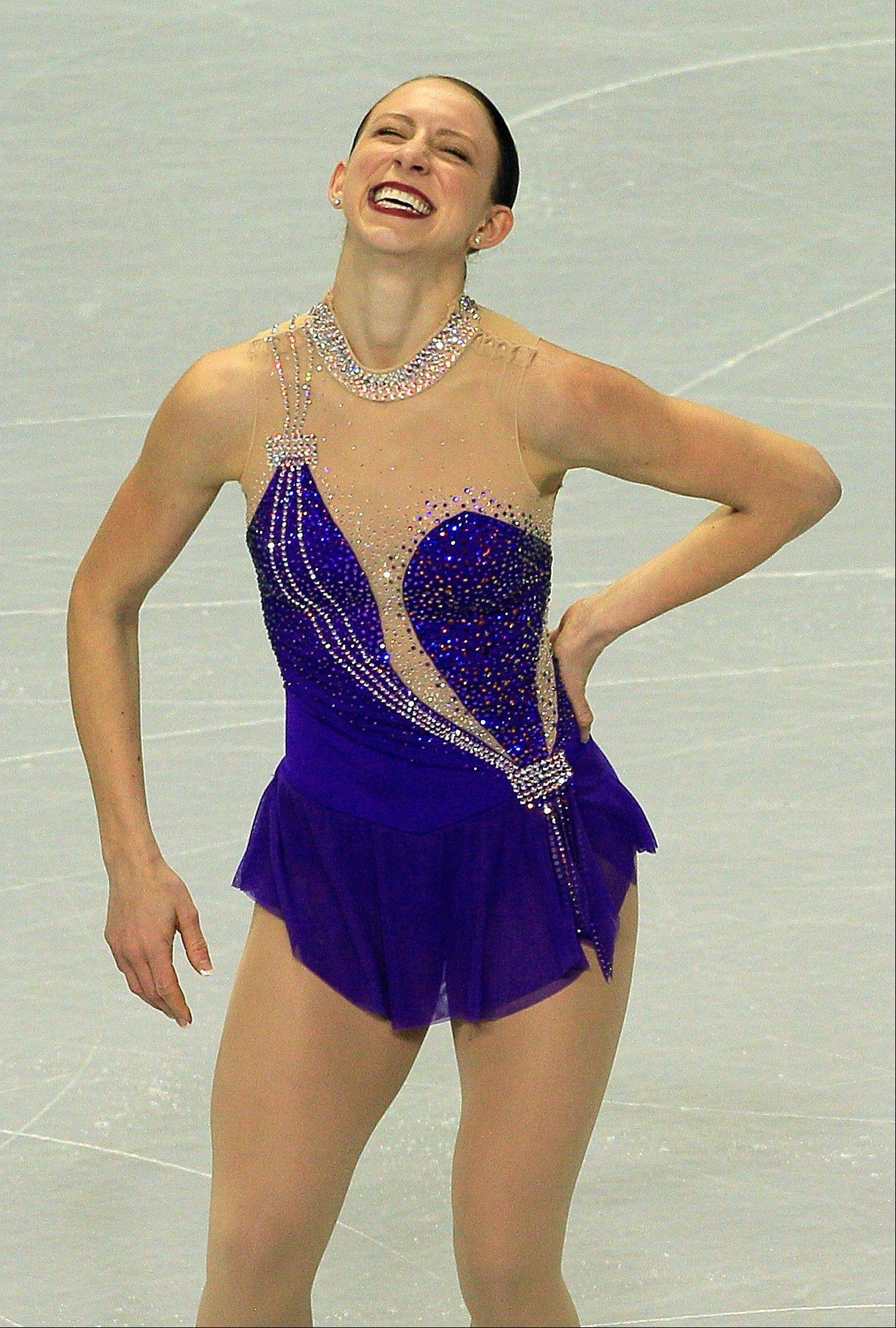 She trains mostly in Colorado, but Des Plaines native Agnes Zawadzki also works trains once a month with David Santee of Park Ridge. She stands in first place heading into Saturday's free skate at the U.S. Figure Skating Championships.
