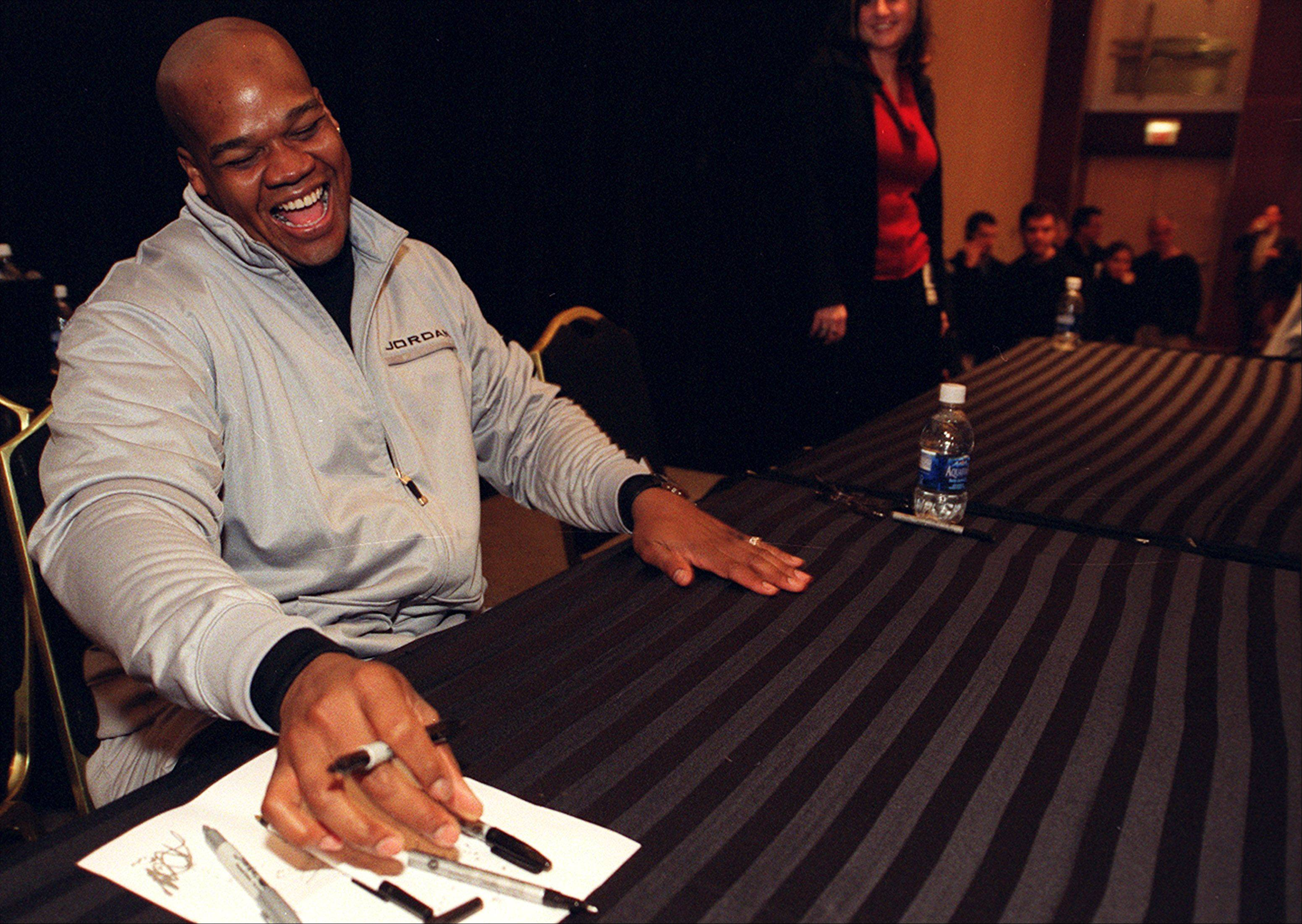 Frank Thomas of the Chicago White Sox laughs with a fan as he signs 800 autographs at SoxFest in Chicago.