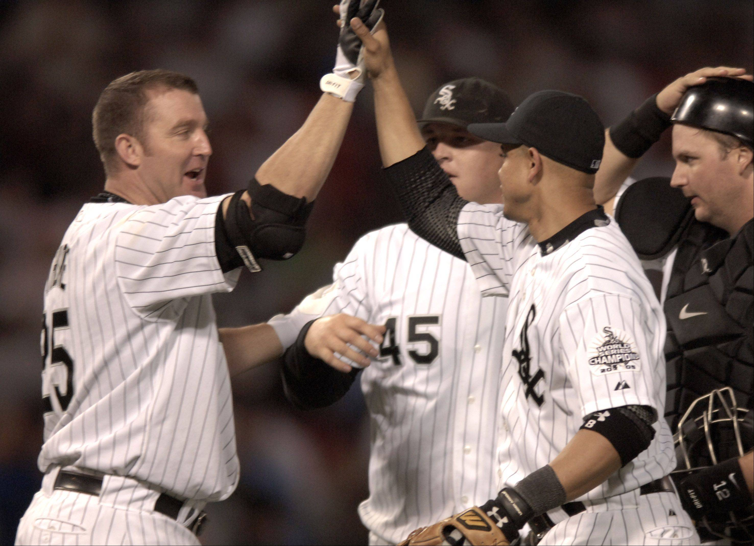 White Sox players celebrate after beating Detroit.