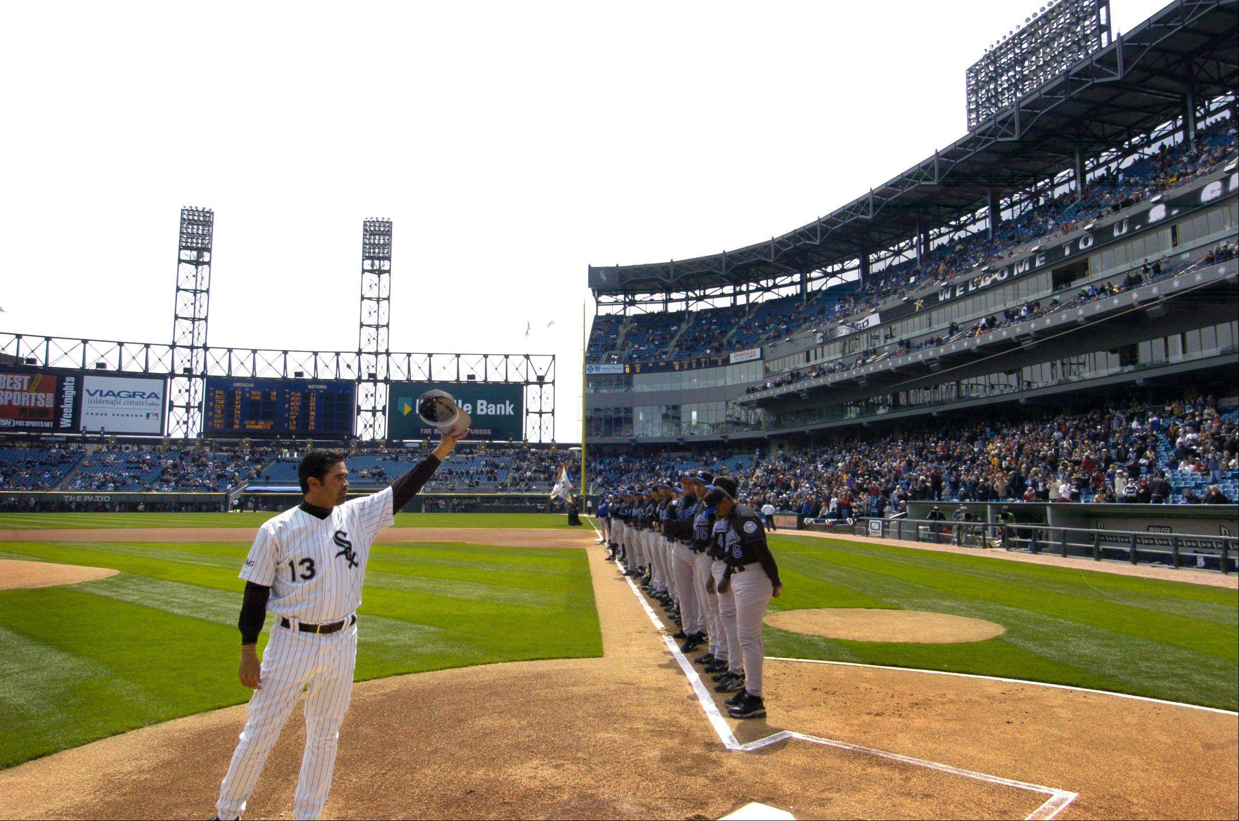 Ozzie Guillen waves to the crowd.