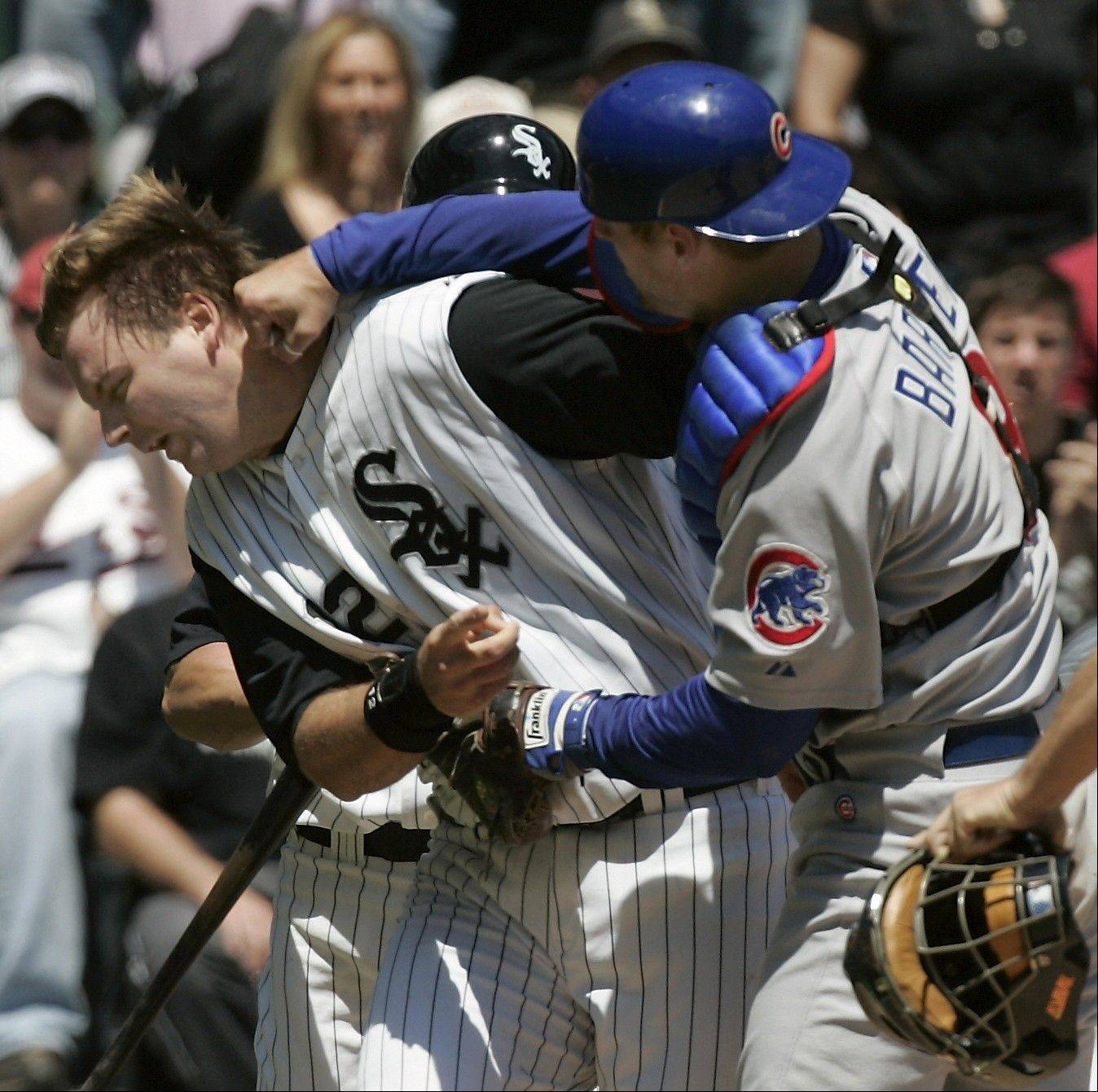 White Sox catcher AJ Pierzynski is punched by Cubs catcher Michael Barrett in the second inning in game two of the season series.
