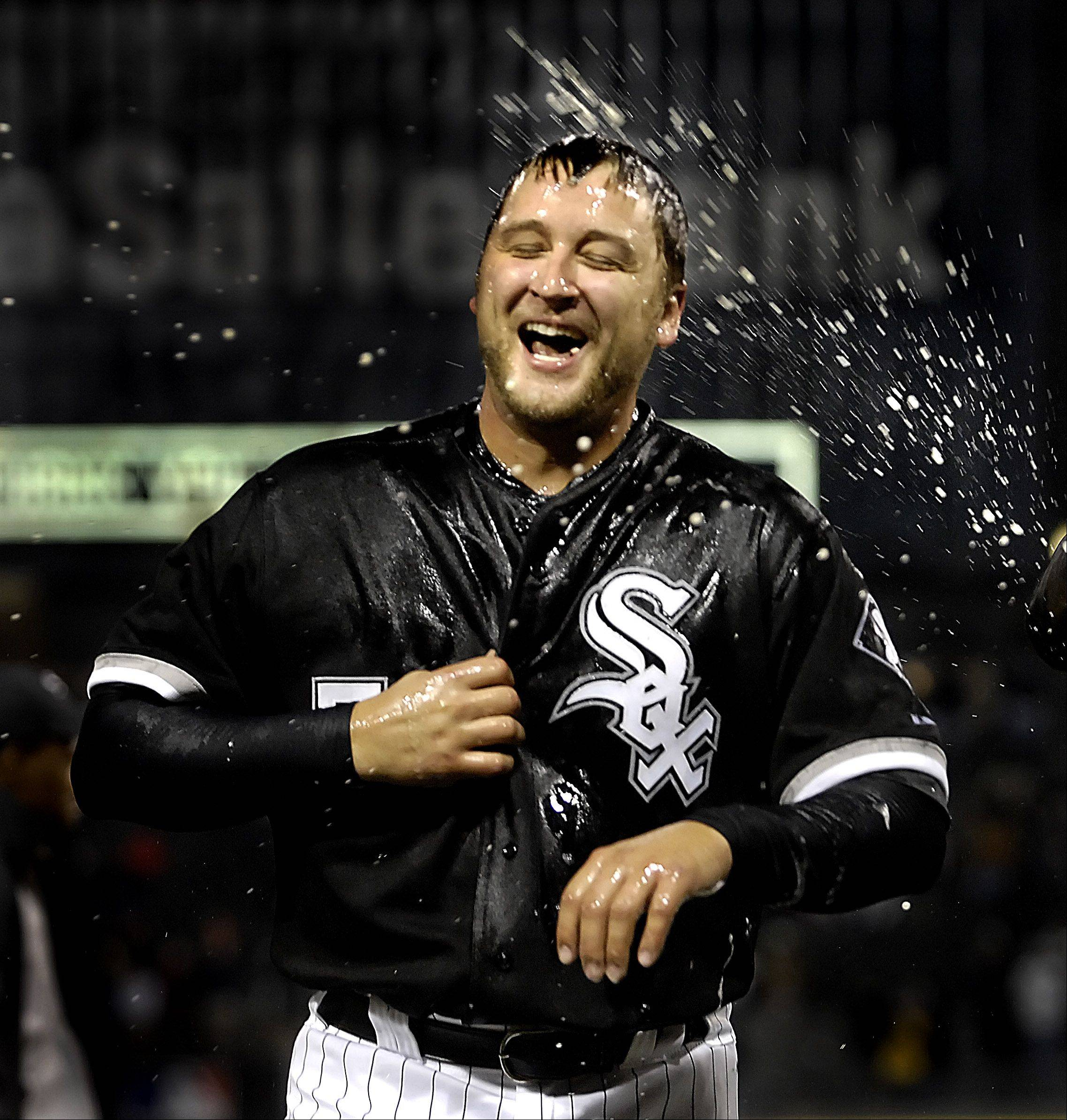 Chicago White Sox starting pitcher Mark Buehrle laughs as his teammate douse him with beer after he threw a one-walk, no-hitter against the Texas Rangers.