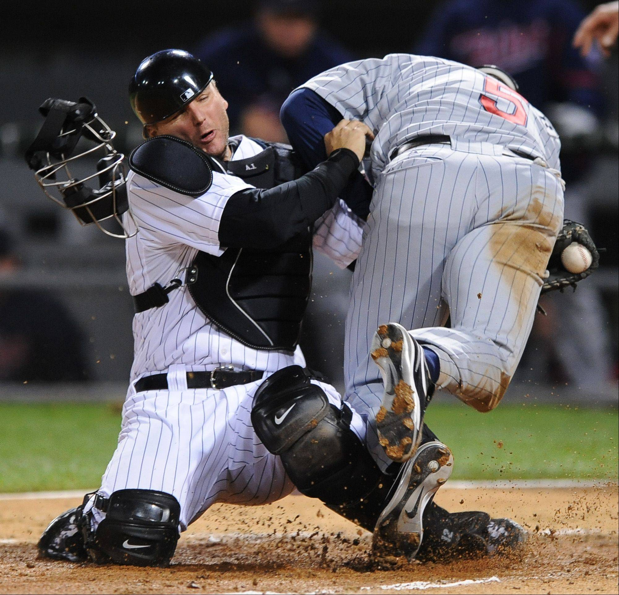 Chicago White Sox catcher A.J. Pierzynski, left, tags out Minnesota Twins' Michael Cuddyer at home during the American League Central Division tiebreaker baseball game in 2008