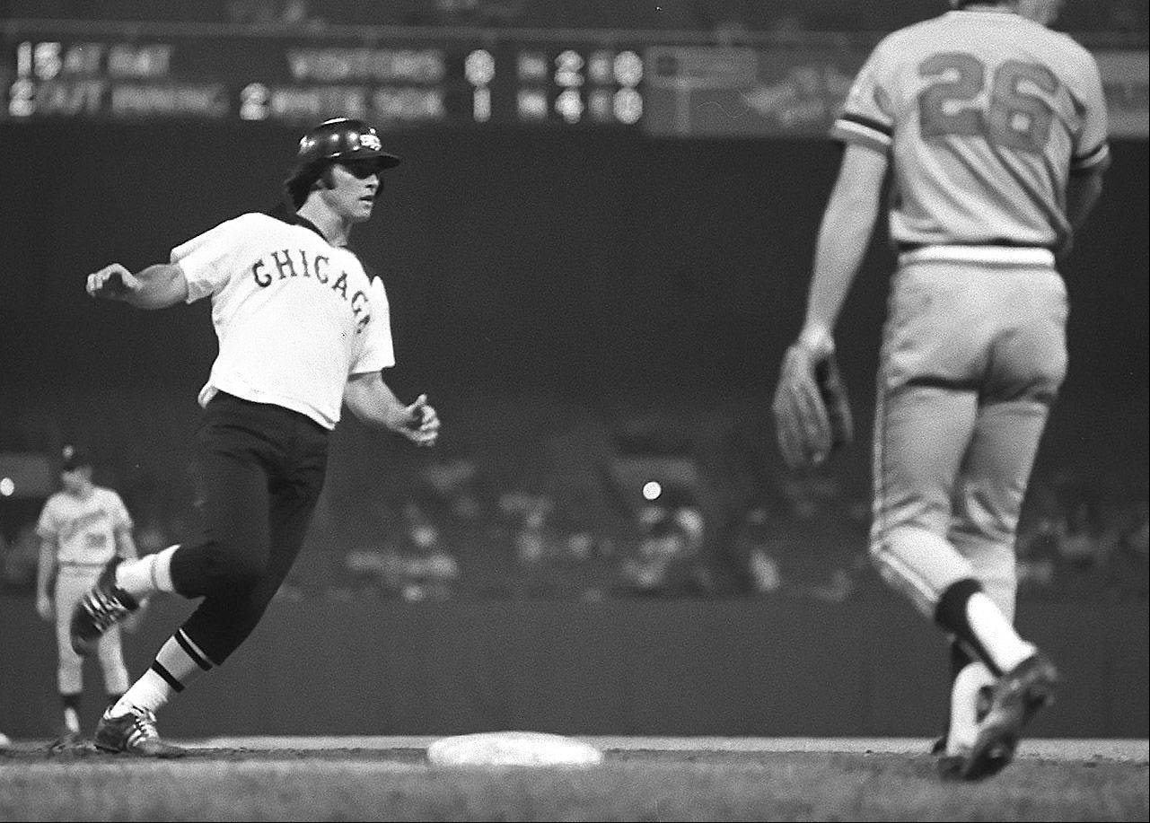 Chicago White Sox infielder Bucky Dent makes it safely to third during a 1976 game against the Twins at Comiskey Park in Chicago. The 1976 White Sox had a 10 game winning streak.