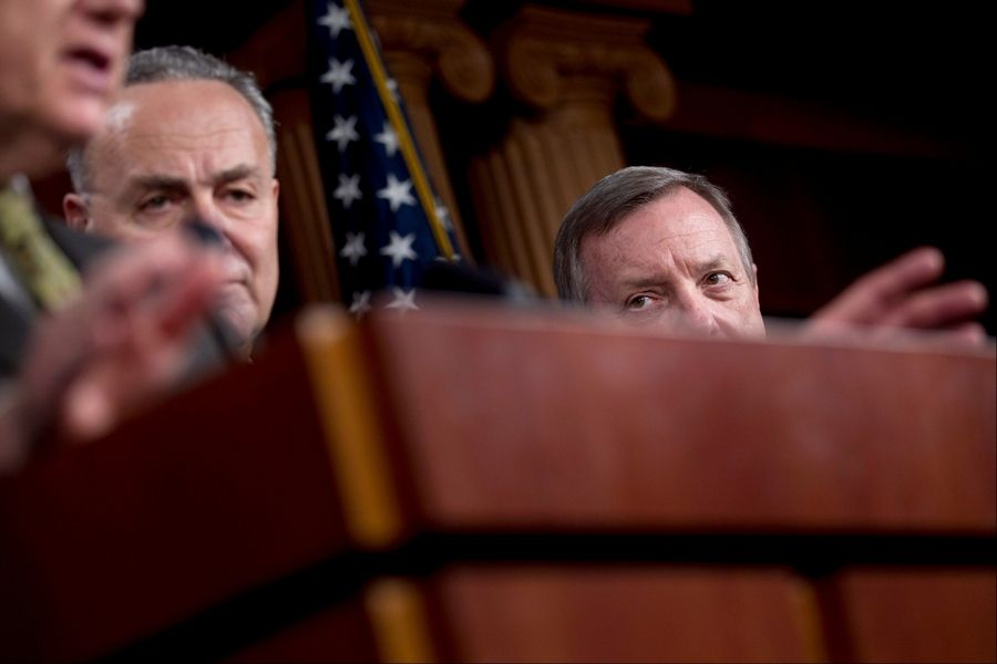 Senate Majority Whip Richard Durbin of Ill., right, and Sen. Charles Schumer, D-N.Y., center, watch as Senate Majority Leader Harry Reid of Nev., talks about the political strategy laid out by President Obama in his State of the Union speech, Wednesday, Jan. 25, 2012, during a news conference on Capitol Hill in Washington.