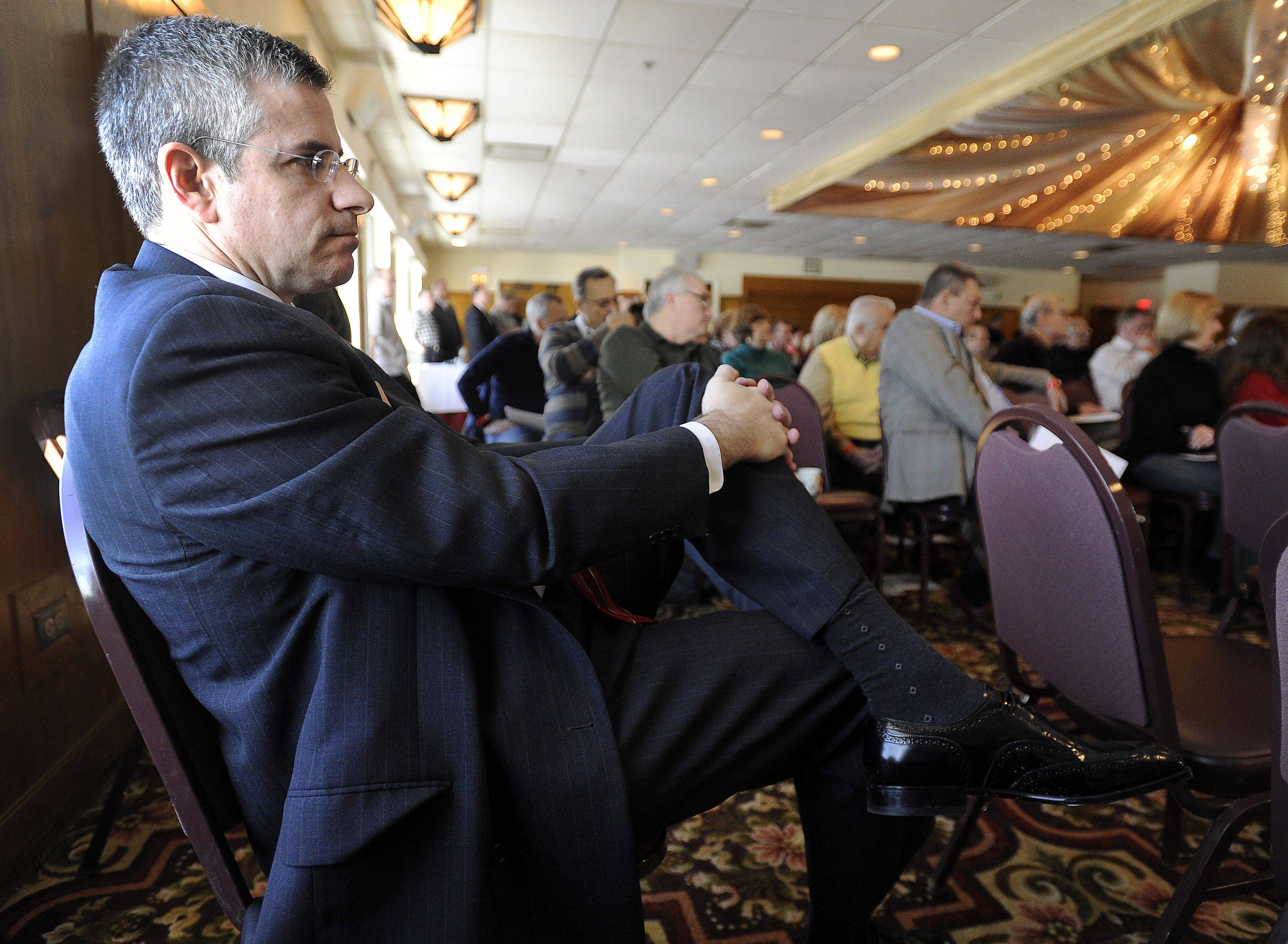 Dan Patlak, an incumbent on the Cook County Board of Review, waits his turn to speak to the overflow crowd at the Schaumburg Township Republican Convention on Saturday.