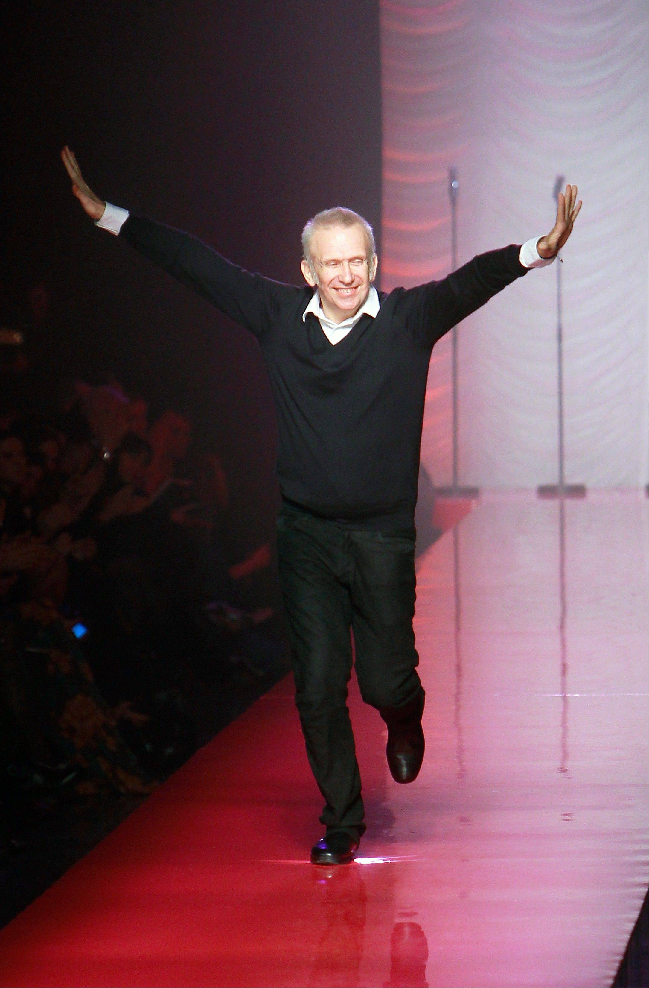 French Fashion designer Jean Paul Gaultier appears at the end of his presentation for Women's Spring Summer 2012 Haute Couture fashion collection presented in Paris, Wednesday, Jan. 25 2012.