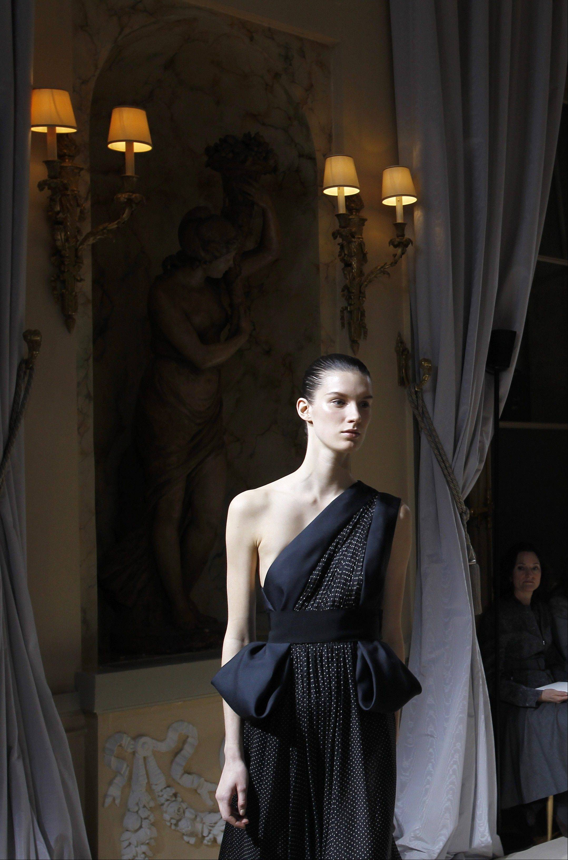 A model wears a creation by Italian fashion designer Giambattista Valli as part of his Women's Spring Summer 2012 Haute Couture fashion collection presented in Paris, Monday, Jan. 23, 2012.