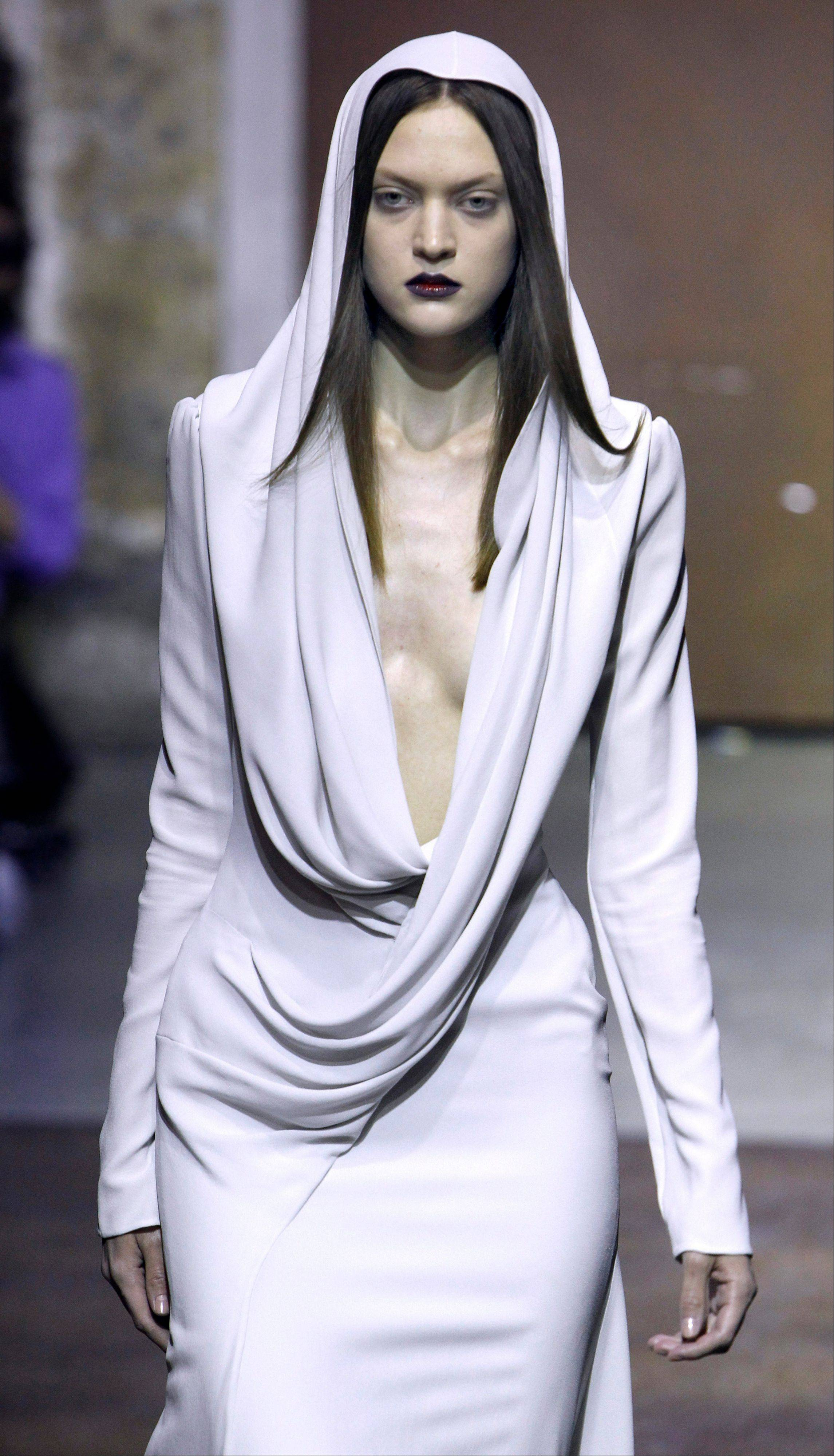 A model wears a creation by Chinese-born French fashion designer Yiqing Yin as part of her Women's Spring Summer 2012 Haute Couture fashion collection presented in Paris Wednesday Jan. 25, 2012.