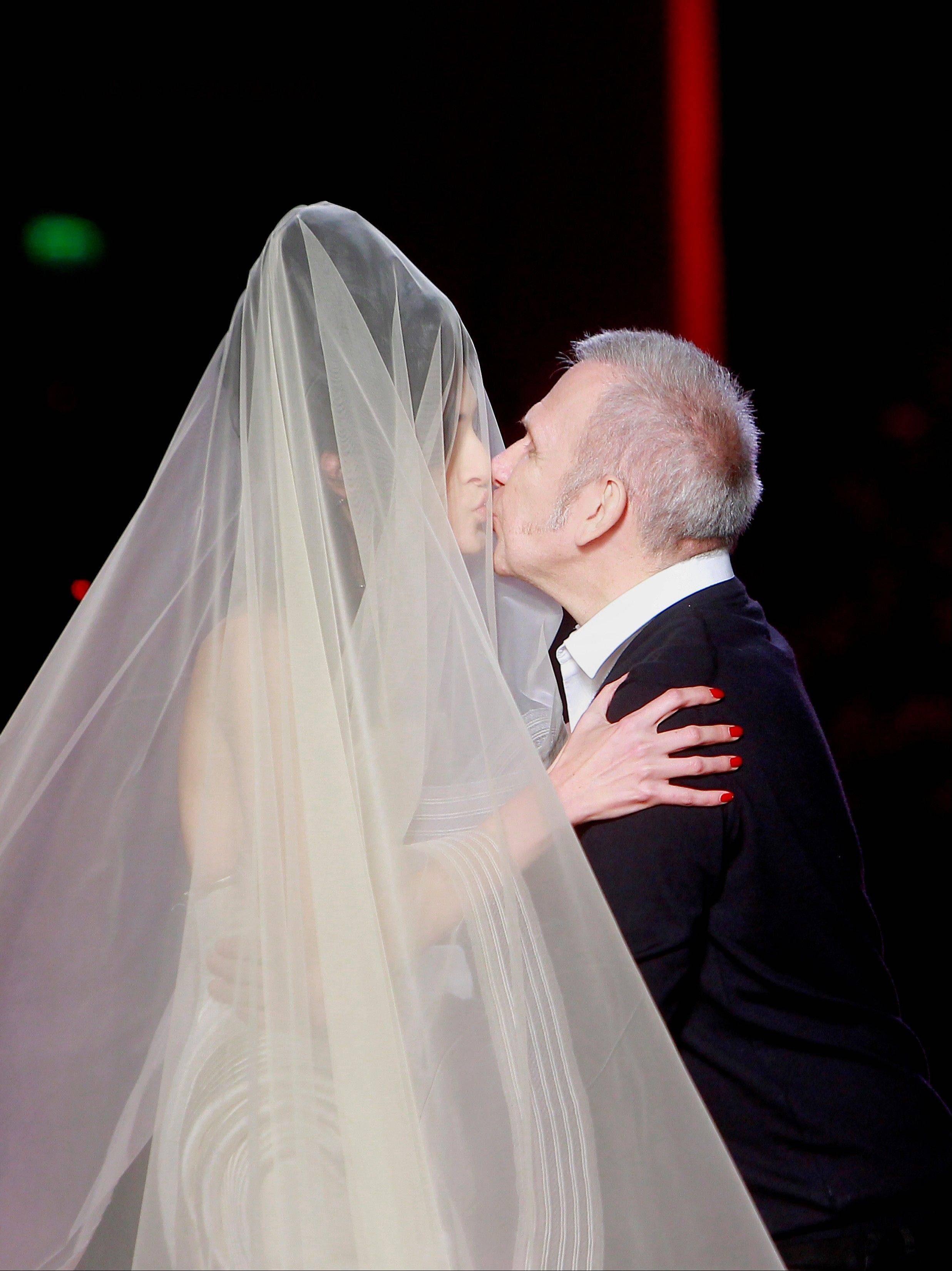 French Fashion designer Jean Paul Gaultier kisses a model after the presentation for Women's Spring Summer 2012 Haute Couture fashion collection presented in Paris, Wednesday, Jan. 25 2012.
