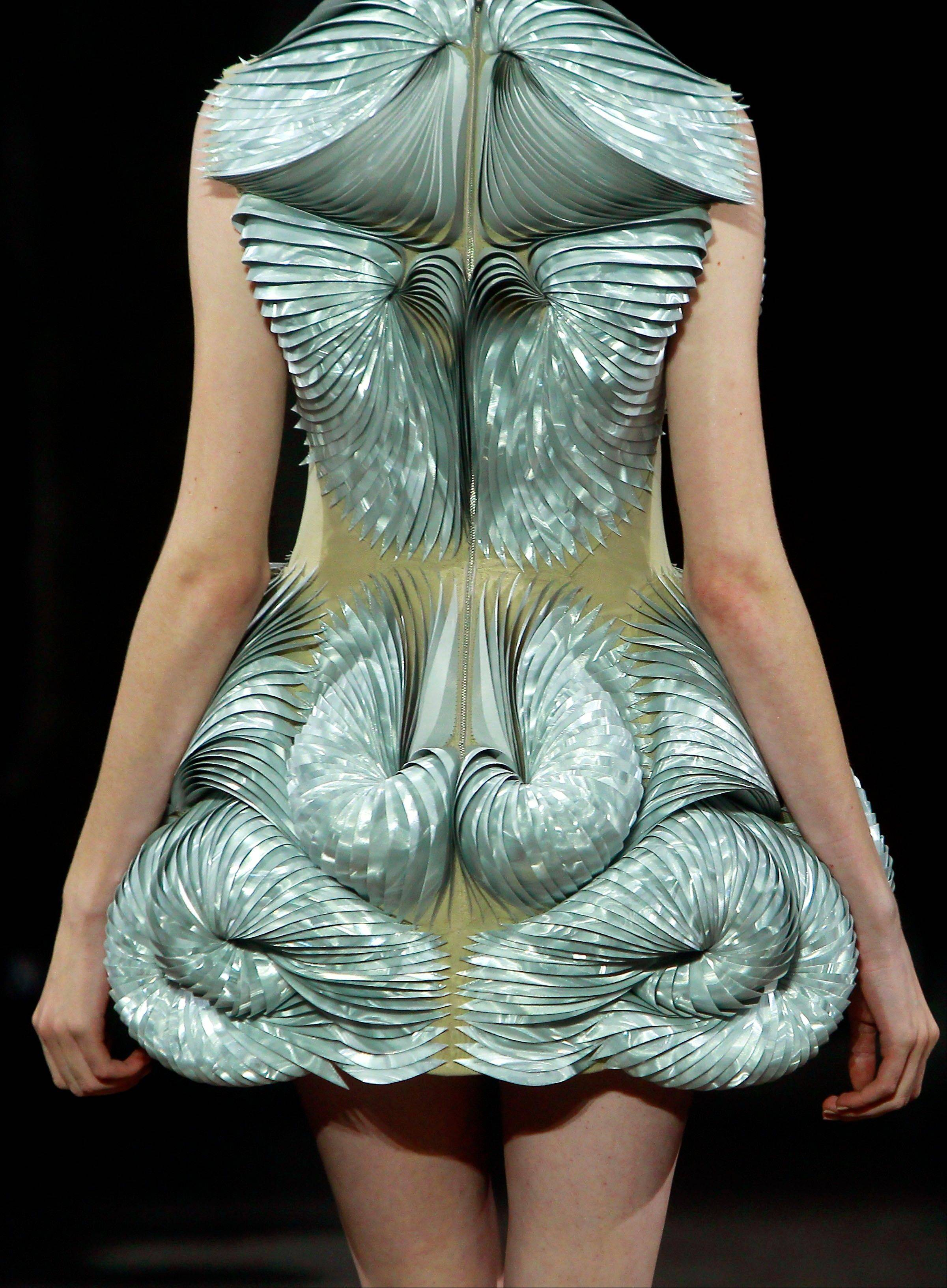 A model wears a creation by Dutch fashion designer Iris van Herpen as part of her Women's Spring Summer 2012 Haute Couture fashion collection presented in Paris, Monday, Jan. 23, 2012.