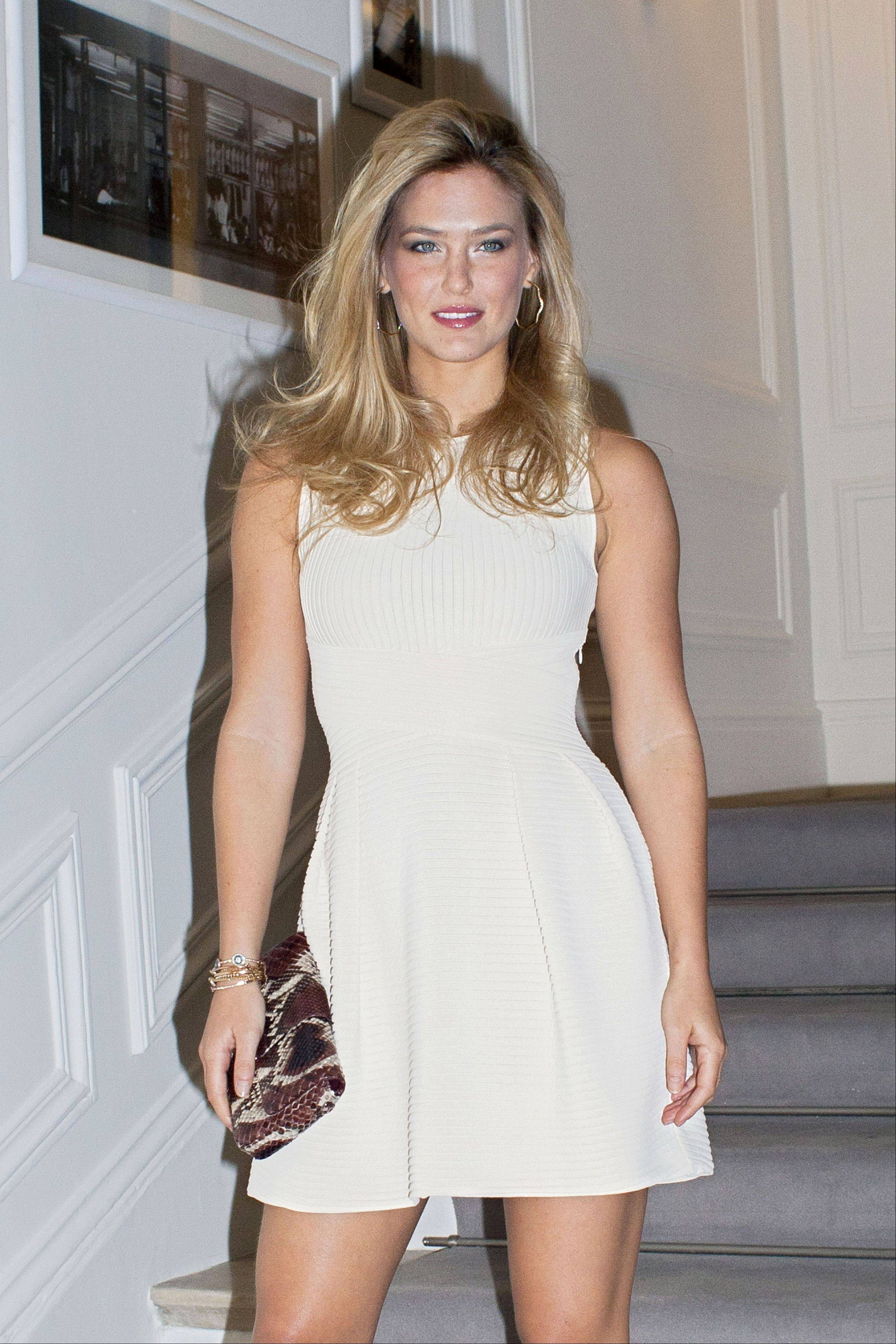 Israeli model Bar Refaeli arrives to the Dior Spring-Summer 2012 Haute Couture fashion collection, in Paris, Monday, Jan. 23, 2012.