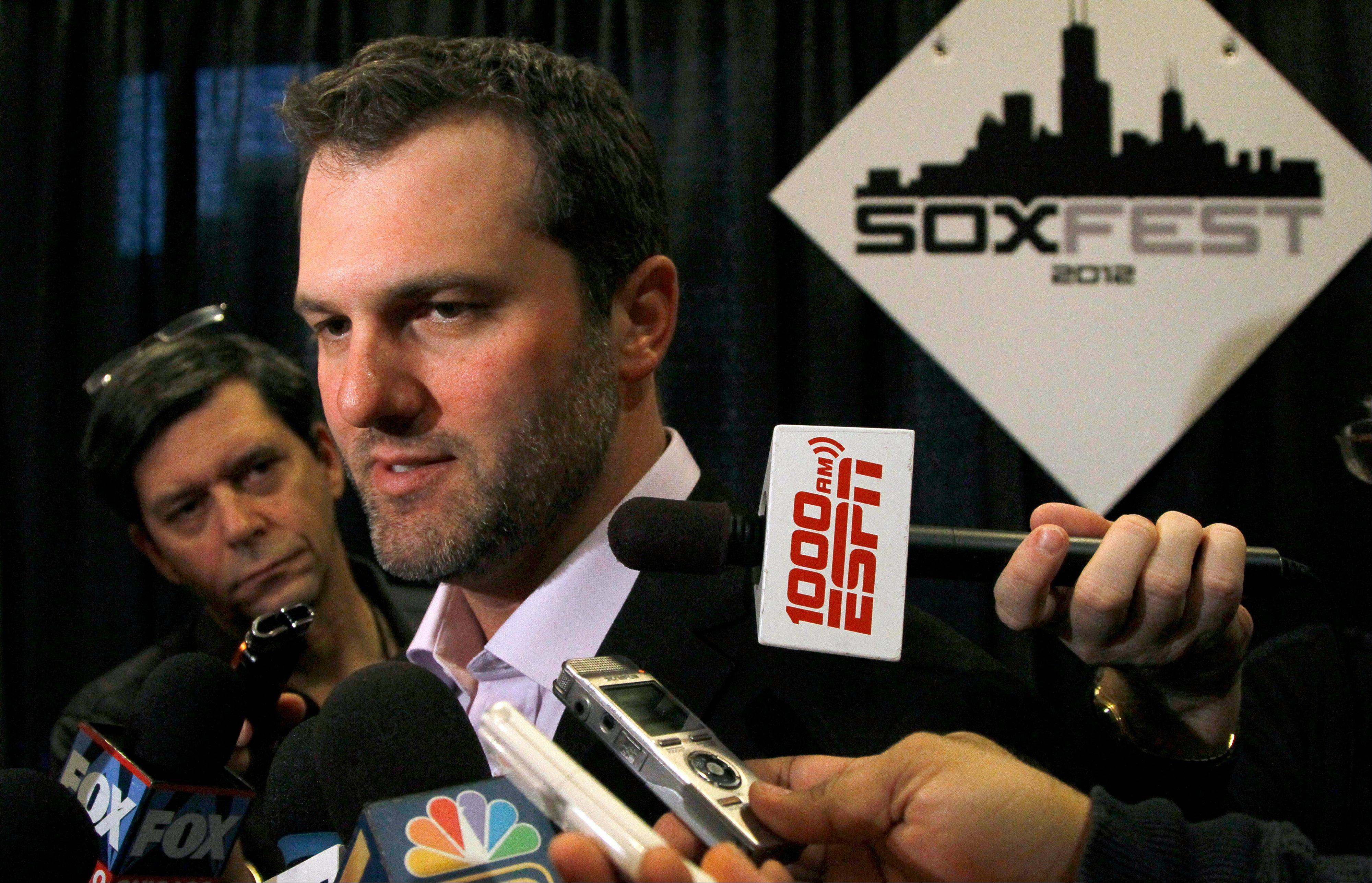 Chicago White Sox baseball captain and first baseman Paul Konerko talks with reporters during the White Sox Fan Fest Friday, Jan. 27, 2012, in Chicago.