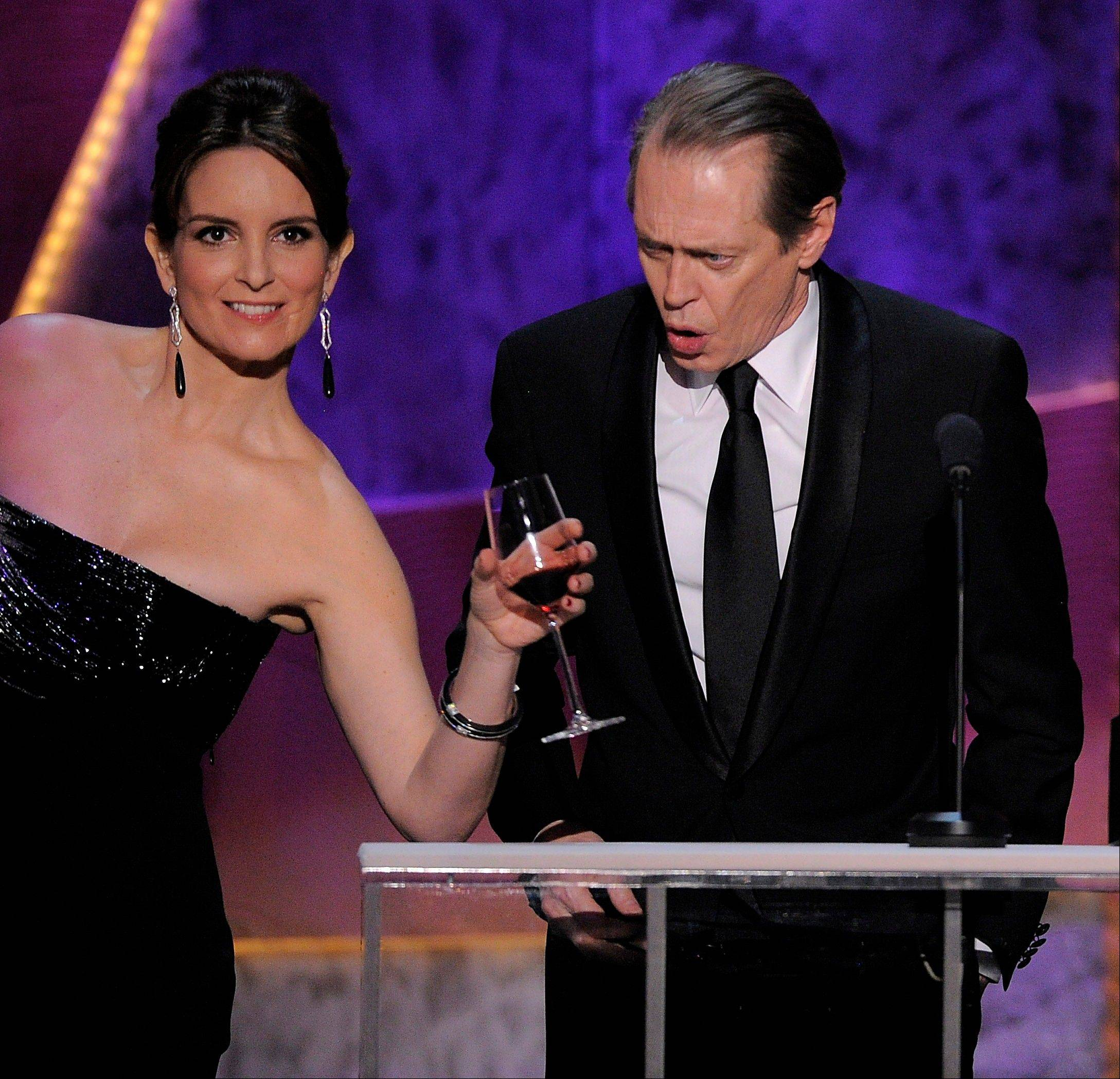 "ASSOCIATED PRESSTina Fey, left, continues her run of humorous appearances at award shows as she presents the award for outstanding performance by a male actor in a drama series to Steve Buscemi for ""Boardwalk Empire"" at the 18th Annual Screen Actors Guild Awards on Sunday in Los Angeles."