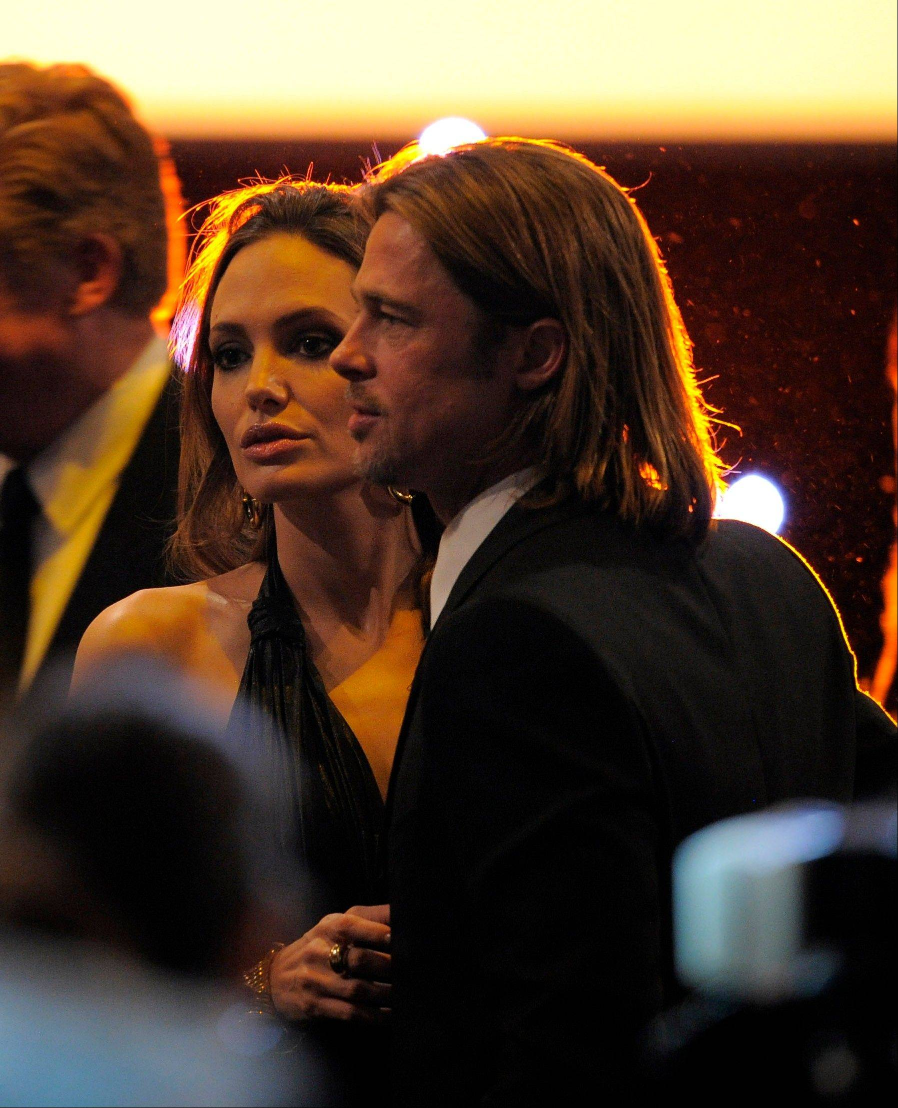 ASSOCIATED PRESSAngelina Jolie, left, and Brad Pitt are seen at the 18th Annual Screen Actors Guild Awards on Sunday Jan. 29, 2012 in Los Angeles.