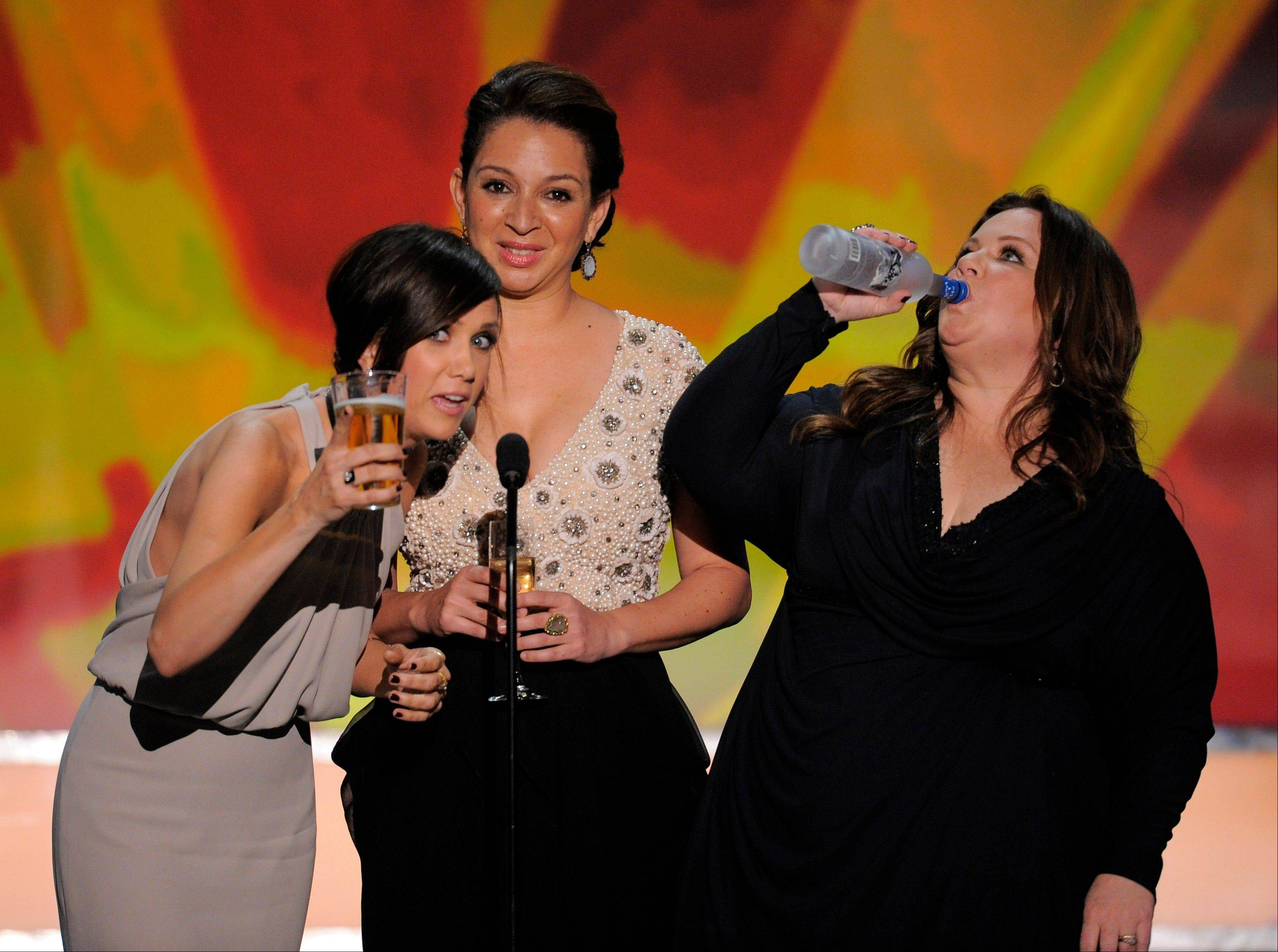 "ASSOCIATED PRESSKristen Wiig, left, Maya Rudolph, center, and Melissa McCarthy, from the film ""Bridesmaids,"" have a little fun while introducing their comedy."