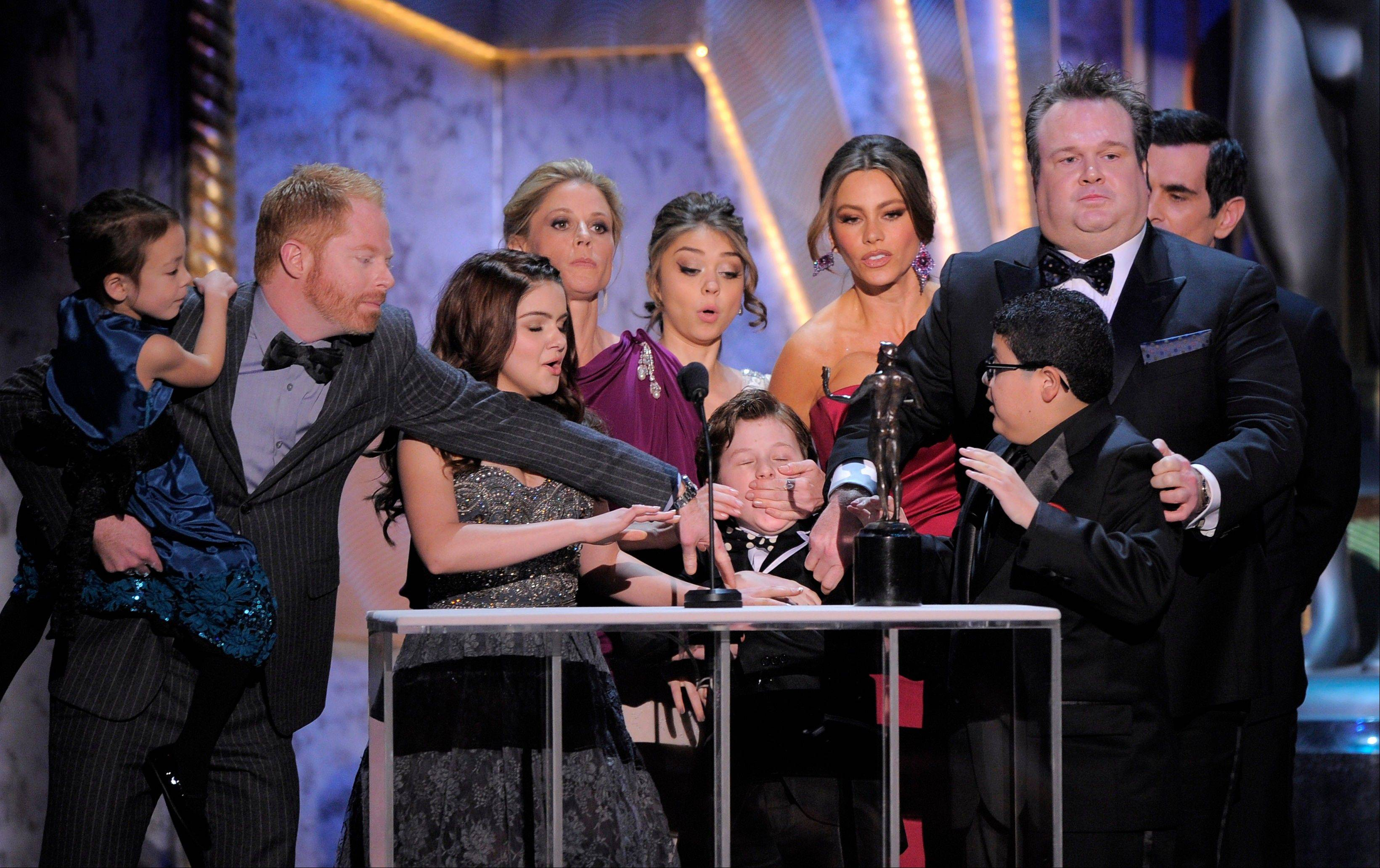 "ASSOCIATED PRESSFrom left, Aubrey Anderson-Emmons, Jesse Tyler Ferguson, Ariel Winter, Julie Bowen, Sarah Hyland, Sofia Vergara, Rico Rodriguez, Eric Stonestreet, and Ty Burrell accept the award for outstanding performance by an ensemble in a comedy series for ""Modern Family."""