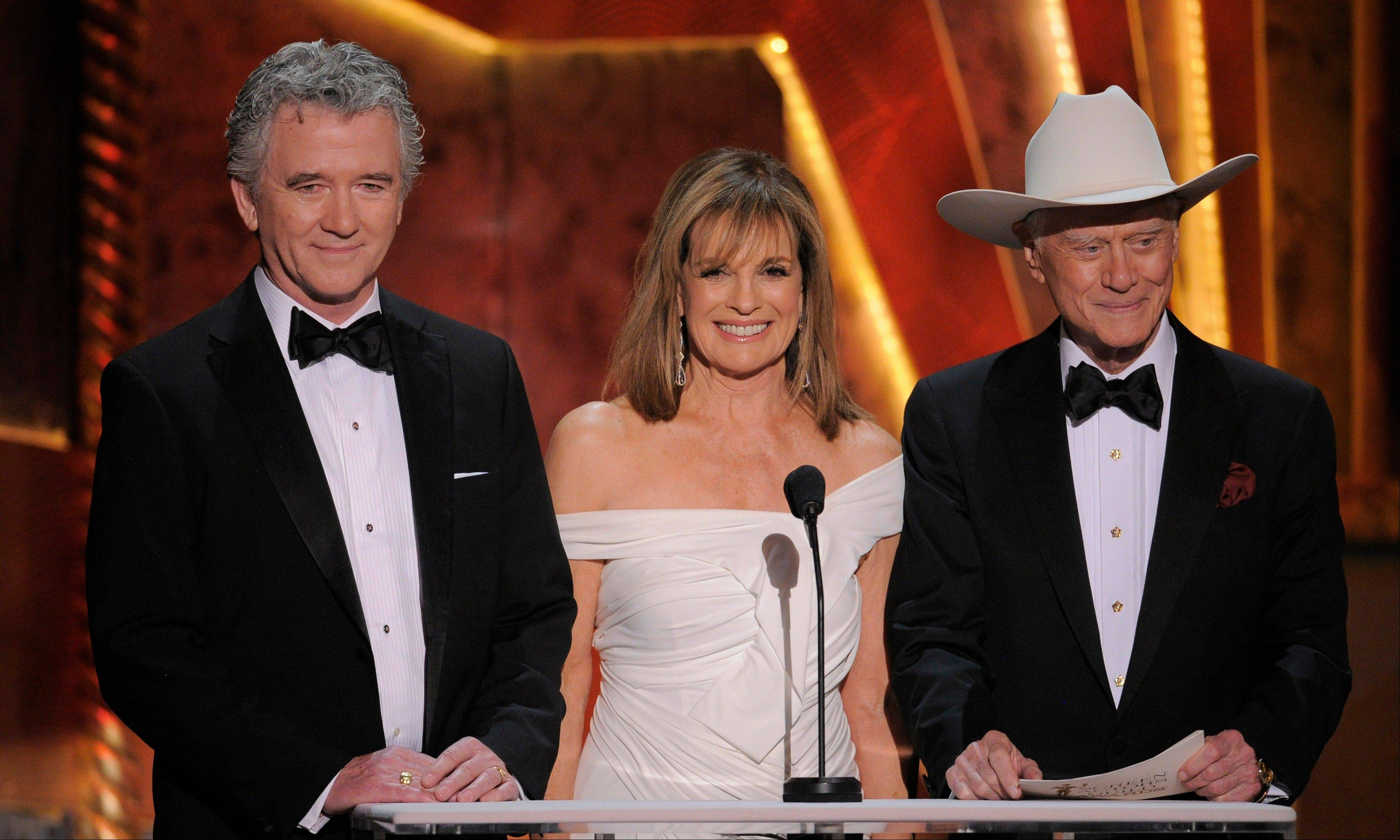 "ASSOCIATED PRESSStars of the upcoming ""Dallas"" reboot Patrick Duffy, left, Linda Gray, center, and Larry Hagman present the award for outstanding performance by an ensemble in a drama series."