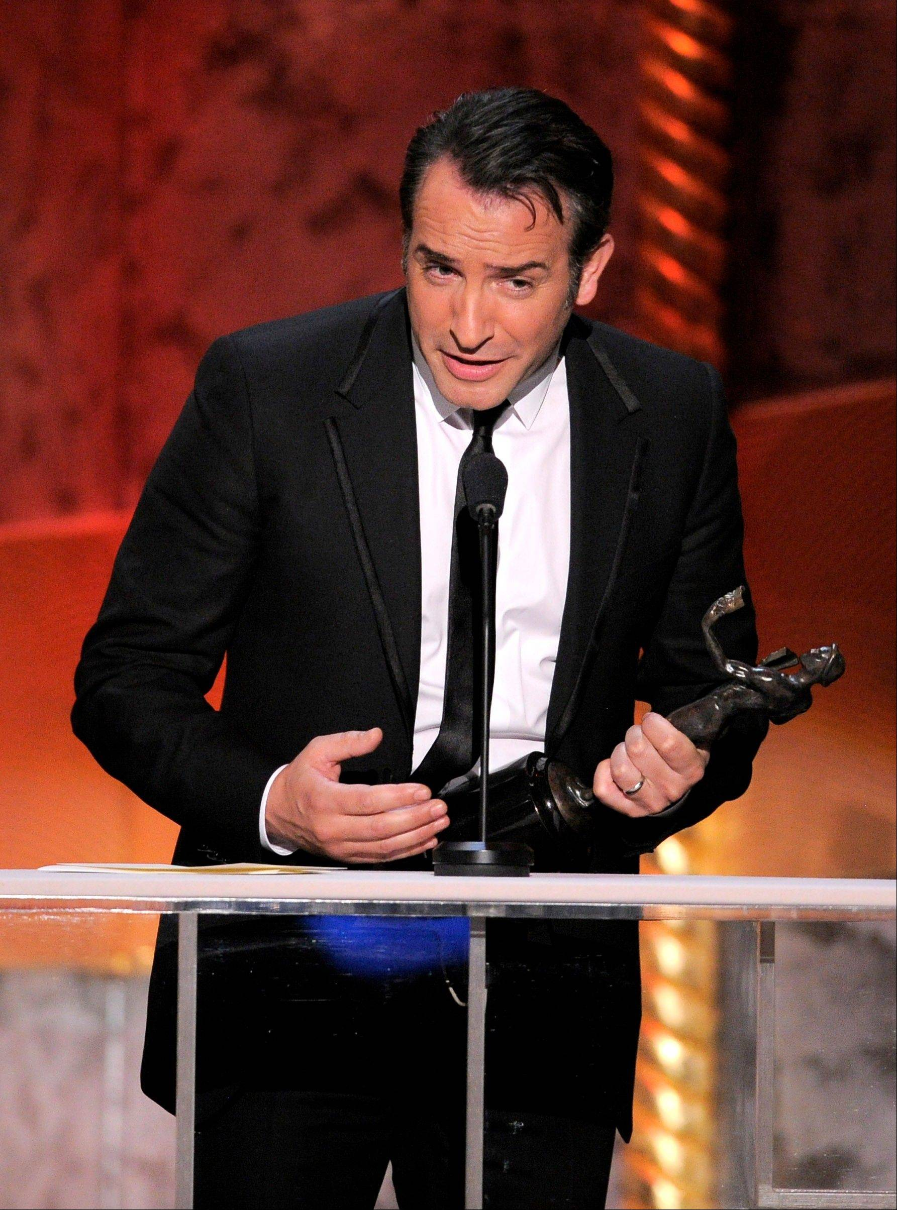 "ASSOCIATED PRESSJean Dejardin accepts the award for outstanding performance by a male actor in a leading role for ""The Artist."""