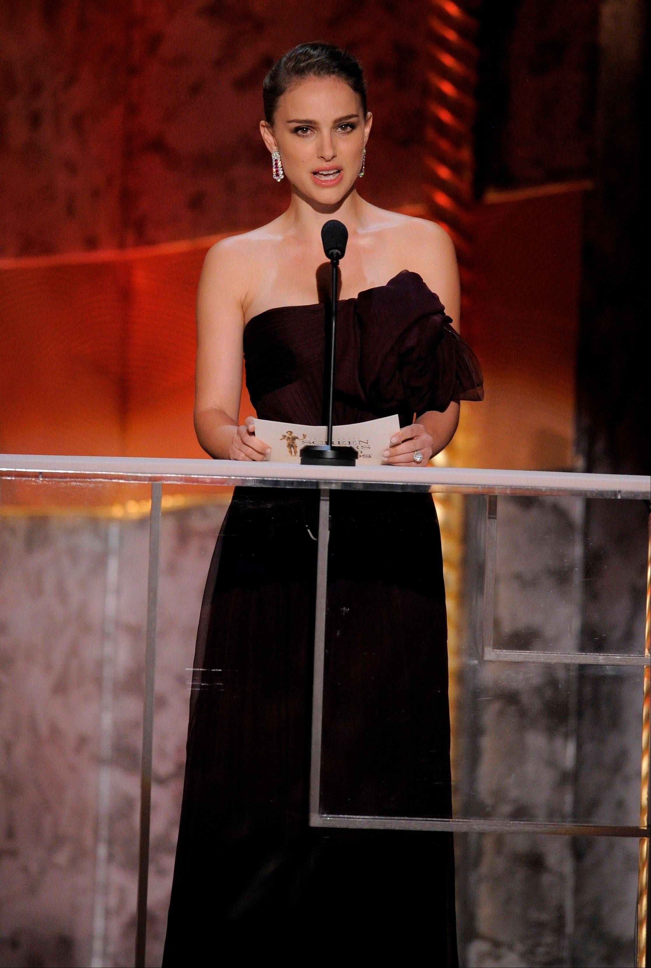 ASSOCIATED PRESSNatalie Portman presents the award for outstanding performance by a male actor in a leading role.