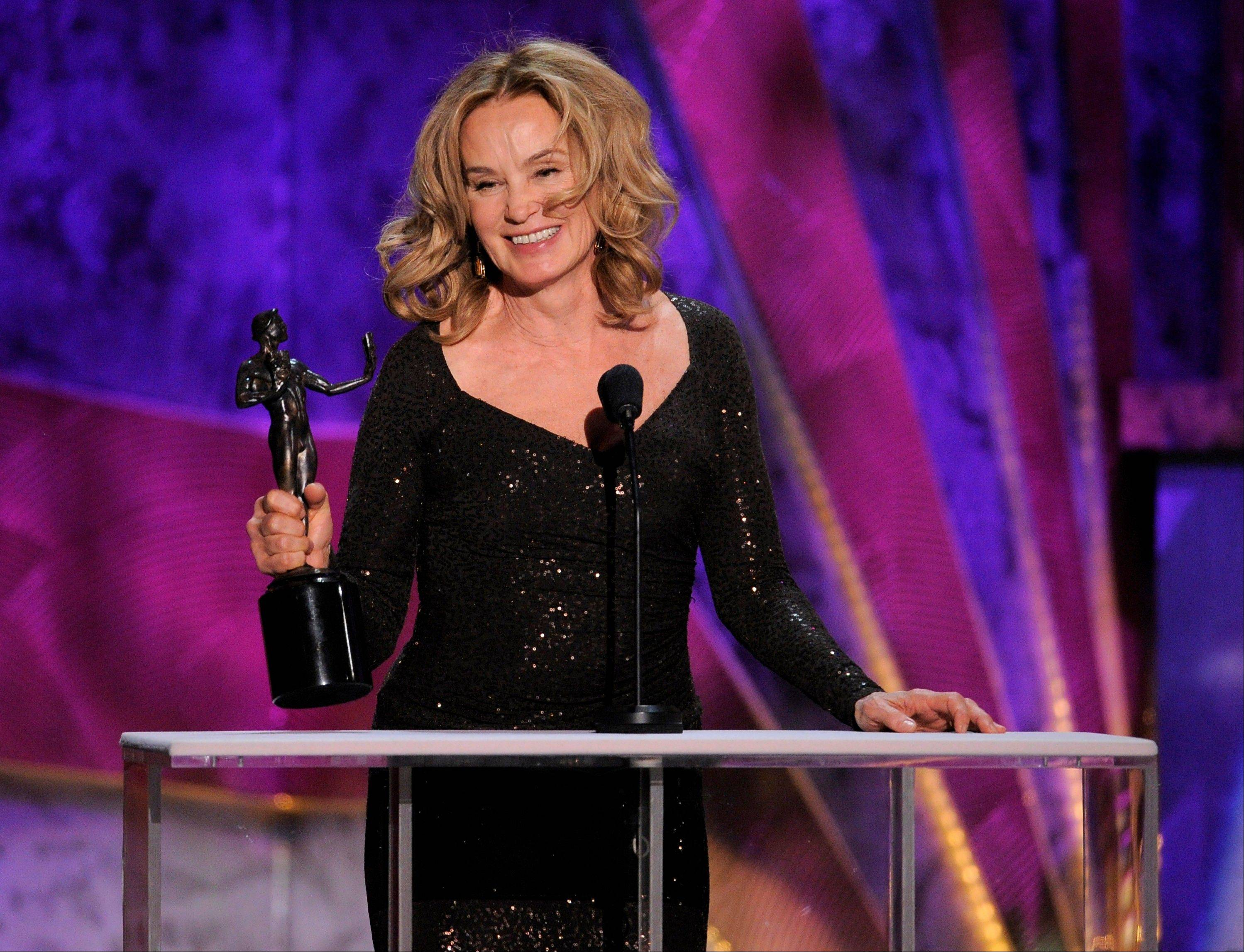 "ASSOCIATED PRESSJessica Lange accepts the award for outstanding performance by a female actor in a drama series for ""American Horror Story"" at the 18th Annual Screen Actors Guild Awards on Sunday in Los Angeles."