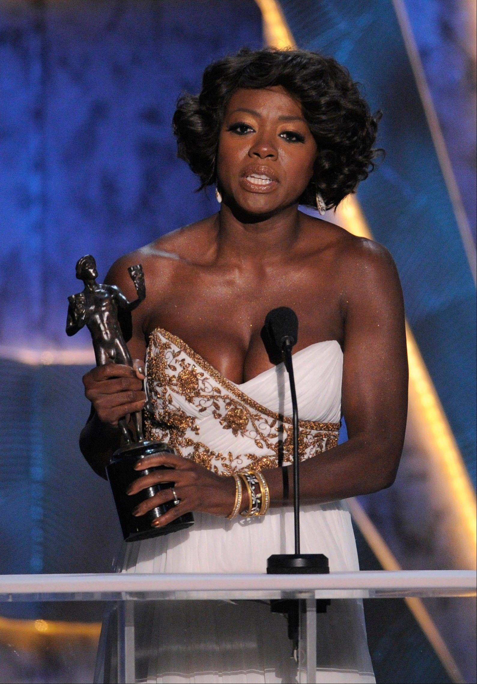 "ASSOCIATED PRESSViola Davis accepts the award for outstanding performance by a female actor in a leading role for ""The Help."""