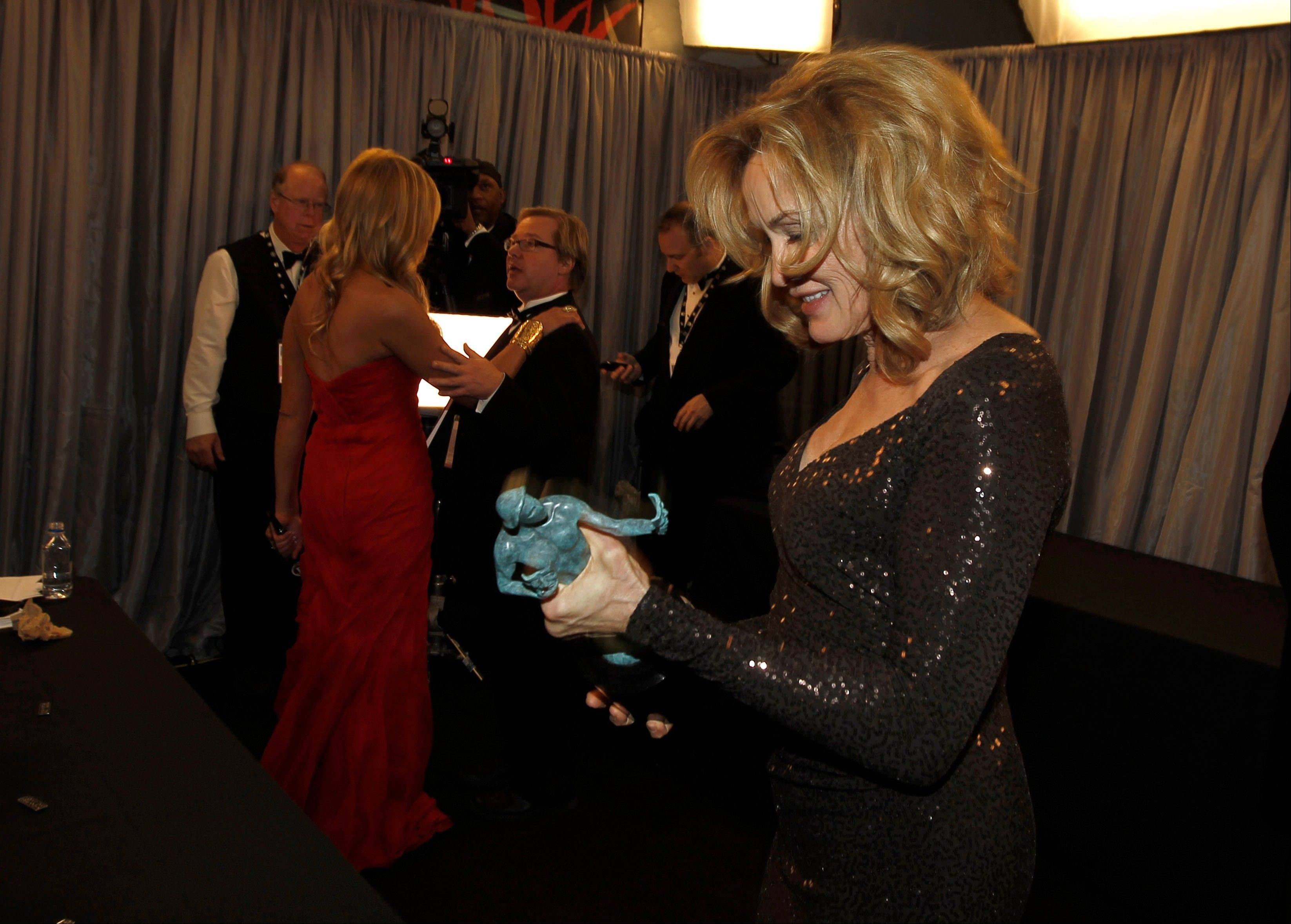 "ASSOCIATED PRESSJessica Lange hangs out backstage after winning the award for outstanding performance by a female actor in a drama series for ""American Horror Story."""