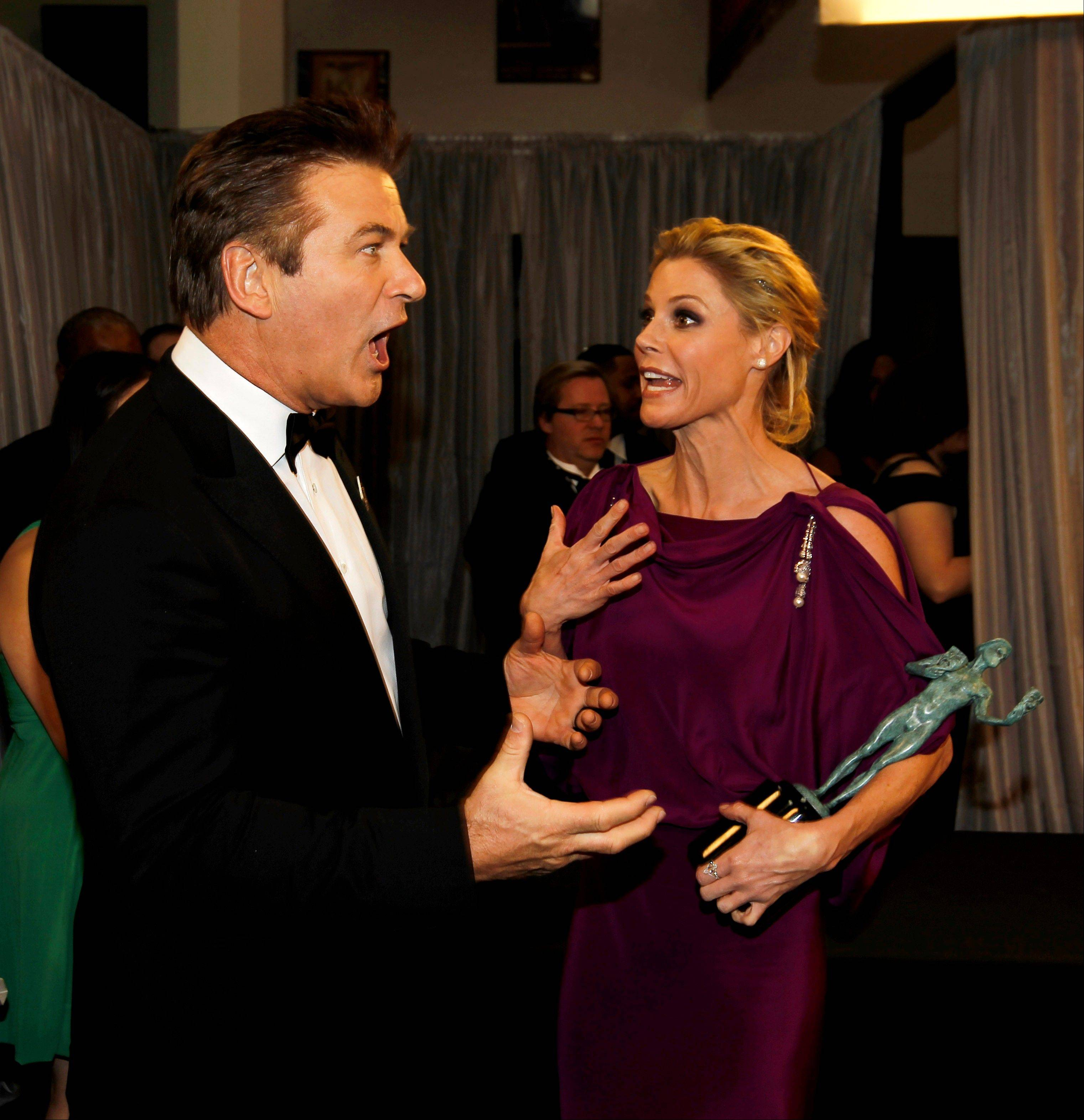 "ASSOCIATED PRESSAlec Baldwin with the award for outstanding performance by a male actor in a comedy series for ""30 Rock,"" left, and Julie Bowen with the award for outstanding performance by an ensemble in a comedy series for ""Modern Family"" have a laugh backstage."
