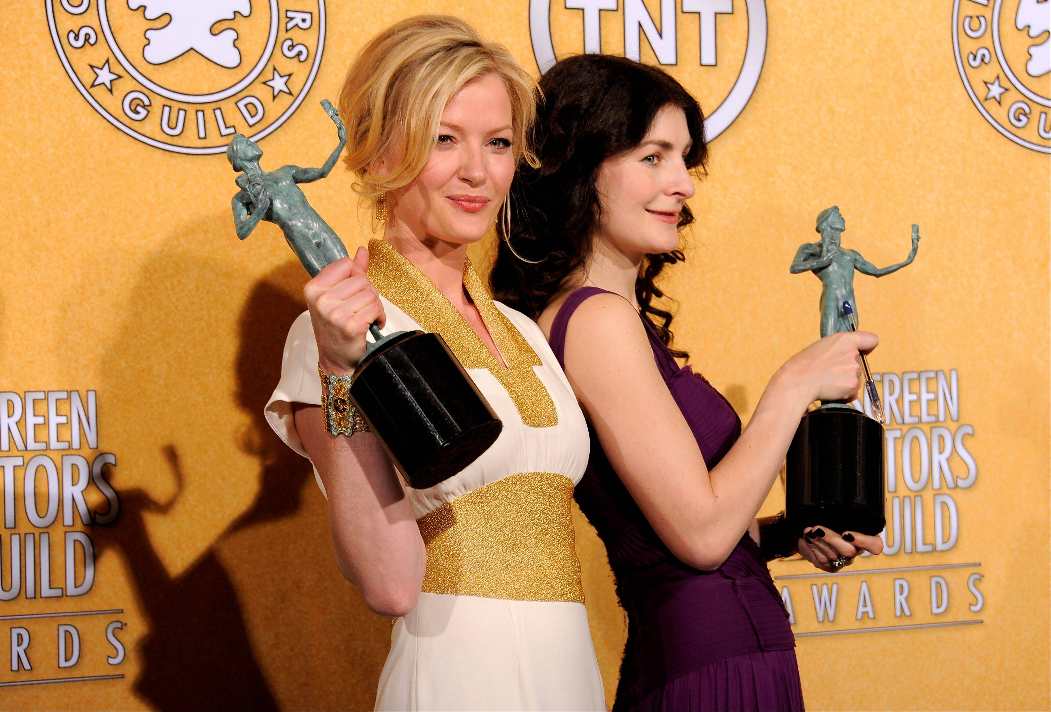 "ASSOCIATED PRESSGretchen Mol, left, and Aleksa Palladino celebrate backstage with the award for outstanding performance by an ensemble in a drama series for ""Boardwalk Empire."""