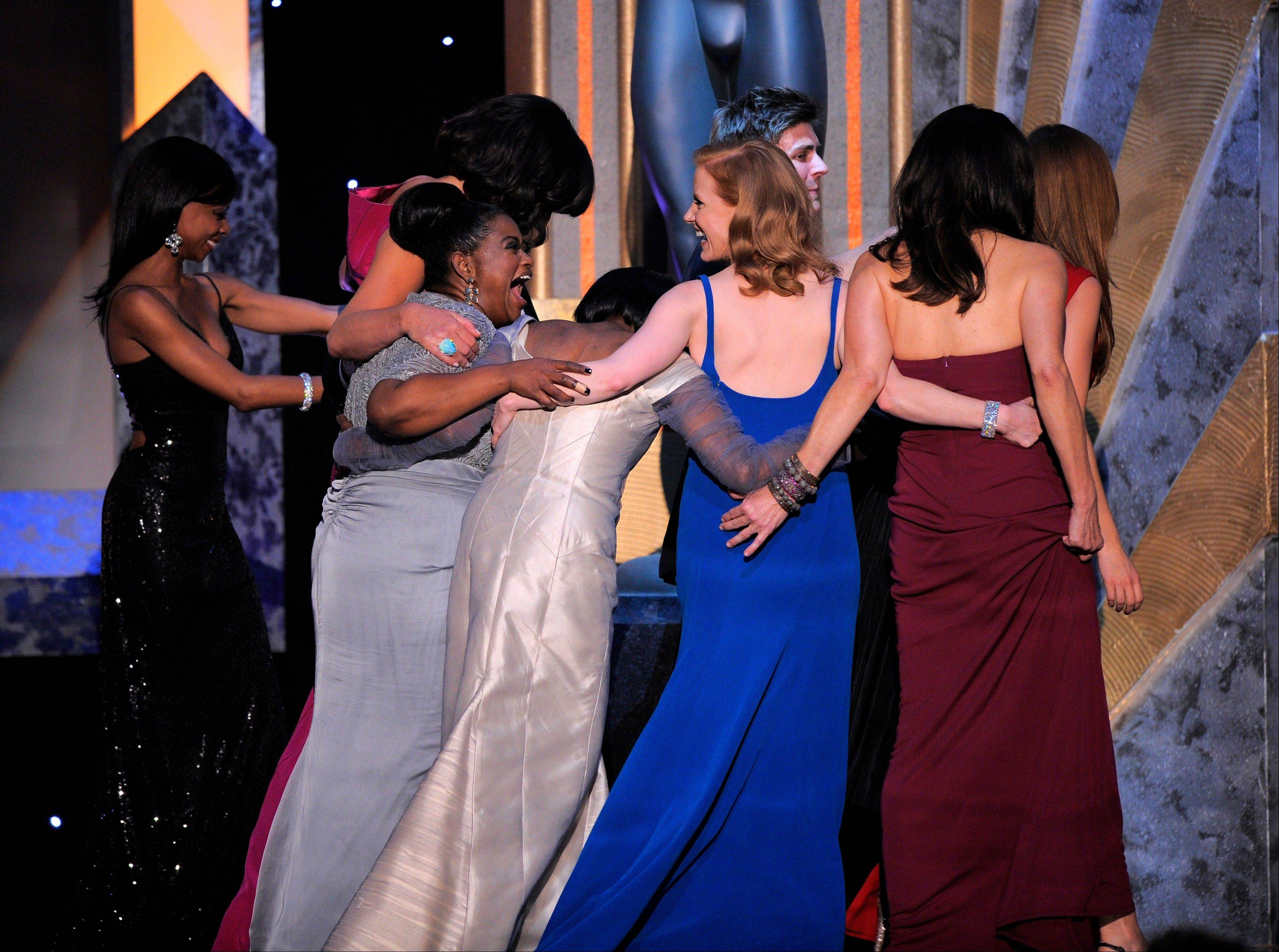 "ASSOCIATED PRESSThe cast of ""The Help"" walks offstage after accepting the award for outstanding performance by a cast in a motion picture."