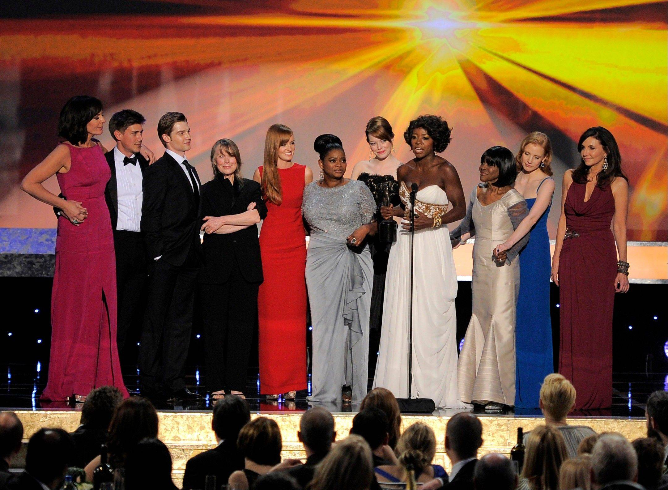 "ASSOCIATED PRESSThe cast of ""The Help"" accepts the award for outstanding performance by a cast in a motion picture. From left, Allison Janney, Chris Lowell, Mike Vogel, Sissy Spacek, Ahna O'Reilly, Octavia Spencer, Emma Stone, Viola Davis, Cicely Tyson, Jessica Chastain and Mary Steenburgen."
