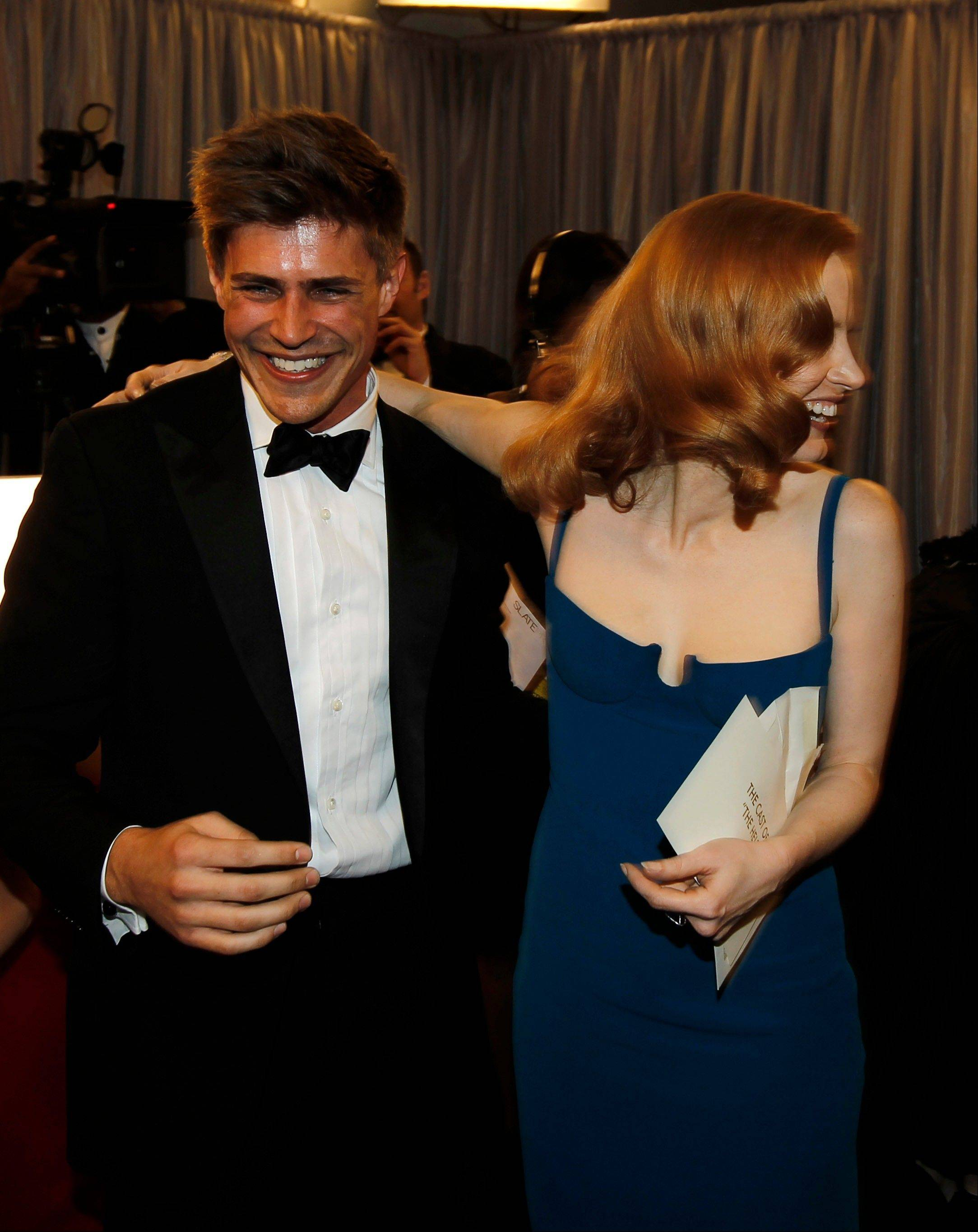 "ASSOCIATED PRESSJessica Chastain, right, and Chris Lowell celebrate backstage with the rest of the cast of ""The Help"" after accepting the award for outstanding performance by a cast in a motion picture."