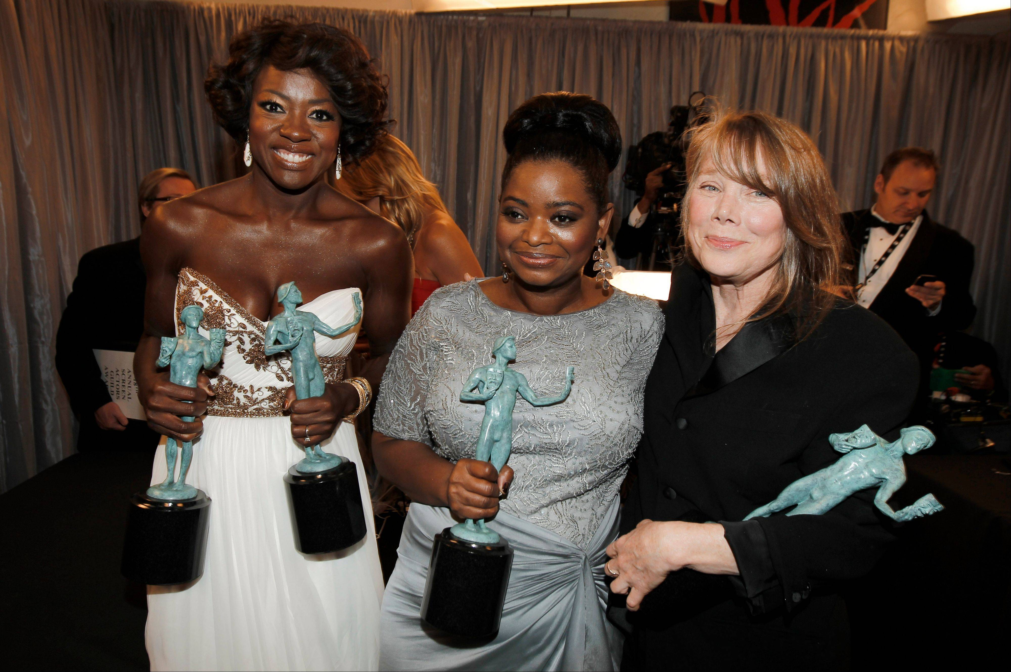 "ASSOCIATED PRESSViola Davis, left, Octavia Spencer, center, and Sissy Spacek are seen backstage after accepting the award for outstanding performance by a cast in a motion picture for ""The Help."" Viola Davis also won the award for outstanding performance by a female actor in a leading role for ""The Help,"" and Octavia Spencer won the best supporting actress award."