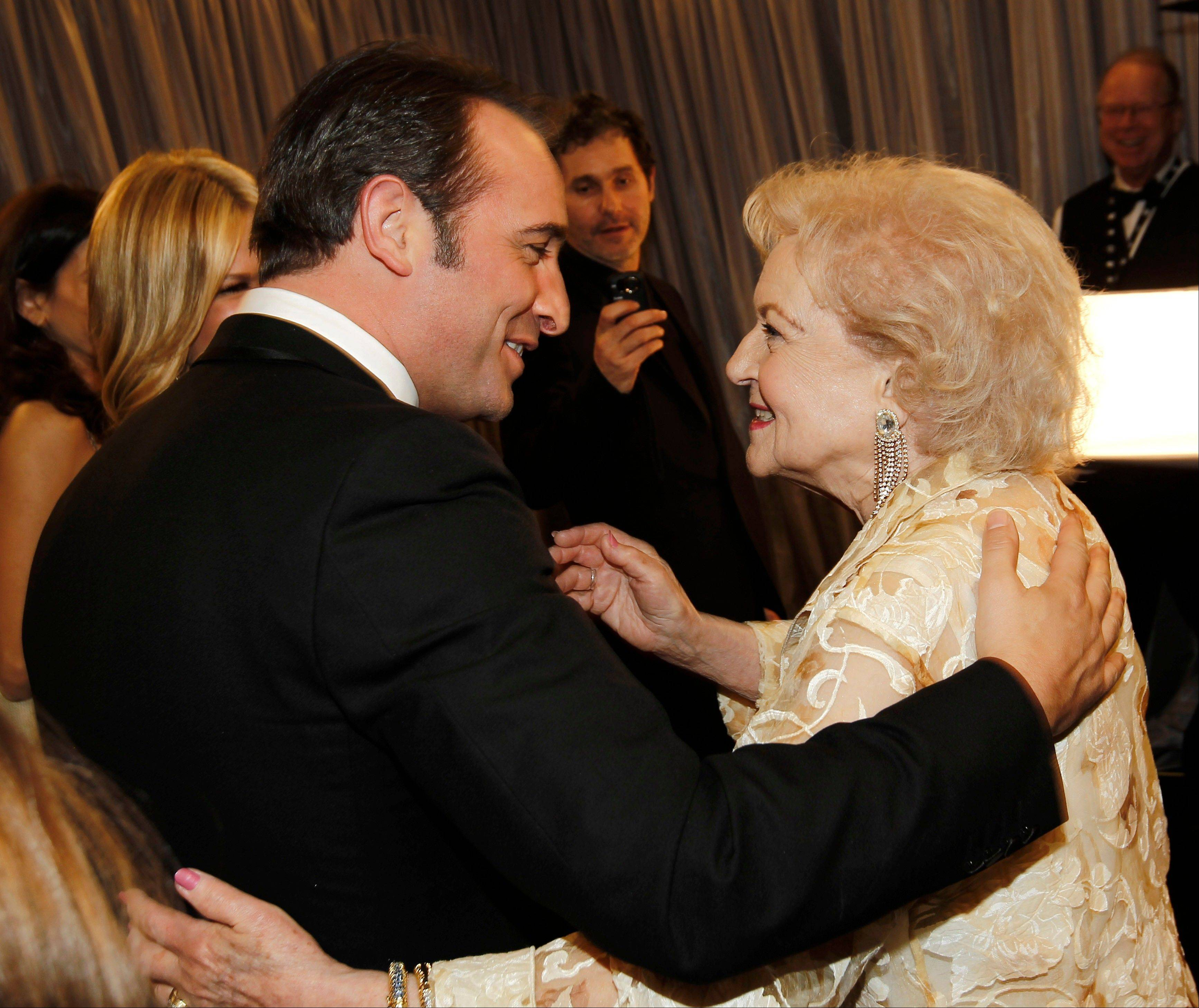 "ASSOCIATED PRESSJean Dujardin greets Betty White backstage after accepting their awards. Jean Dujardin won the award for outstanding performance by a male actor in a leading role for ""The Artist"" and Betty White won the award for outstanding performance by a female actor in a comedy series for ""Hot in Cleveland."""