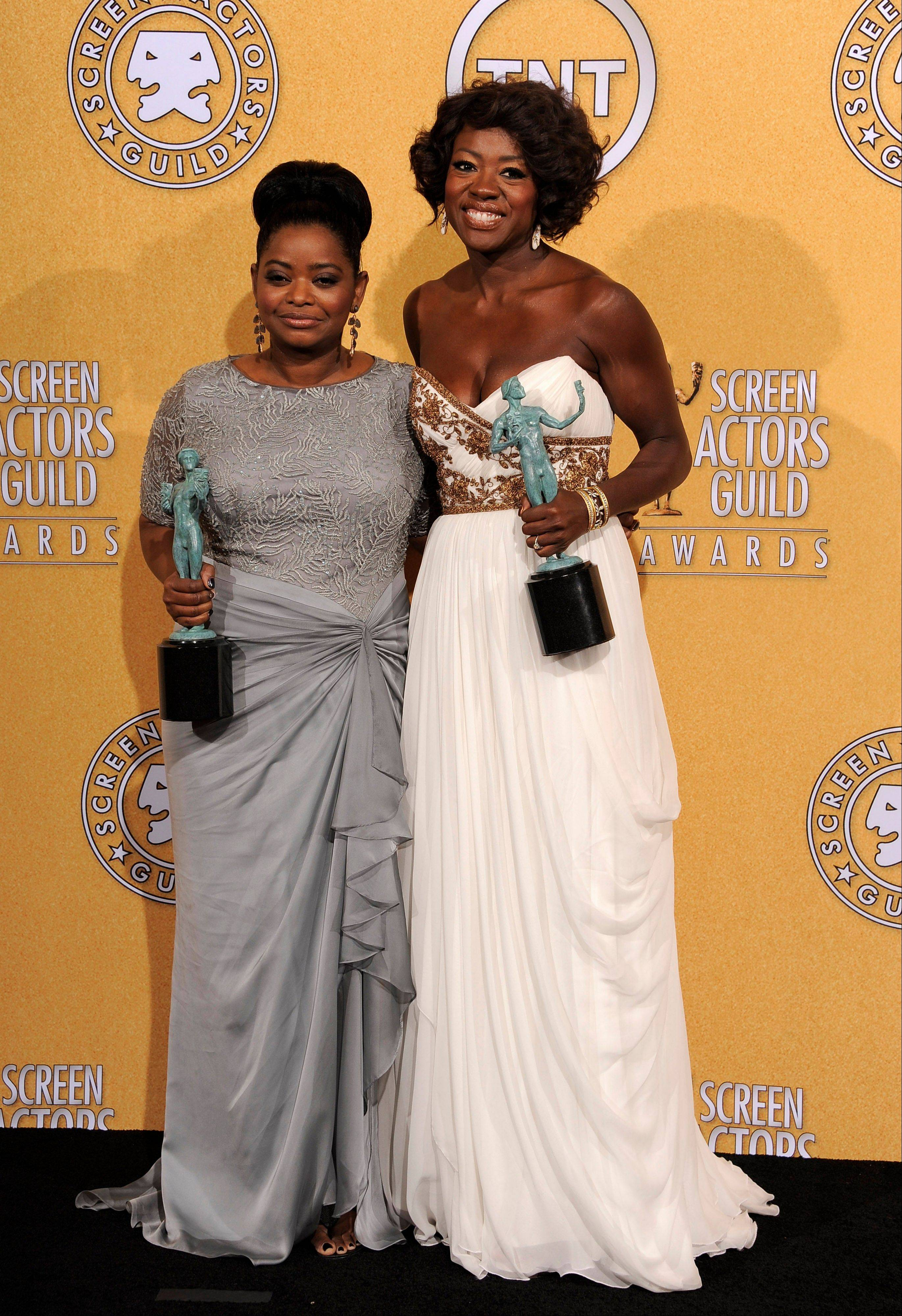 "ASSOCIATED PRESSOctavia Spencer, winner of the award for outstanding performance by a female actor in a supporting role for ""The Help,"" left, and Viola Davis, winner of the award for outstanding performance by a female actor in a leading role for ""The Help,"" pose backstage."