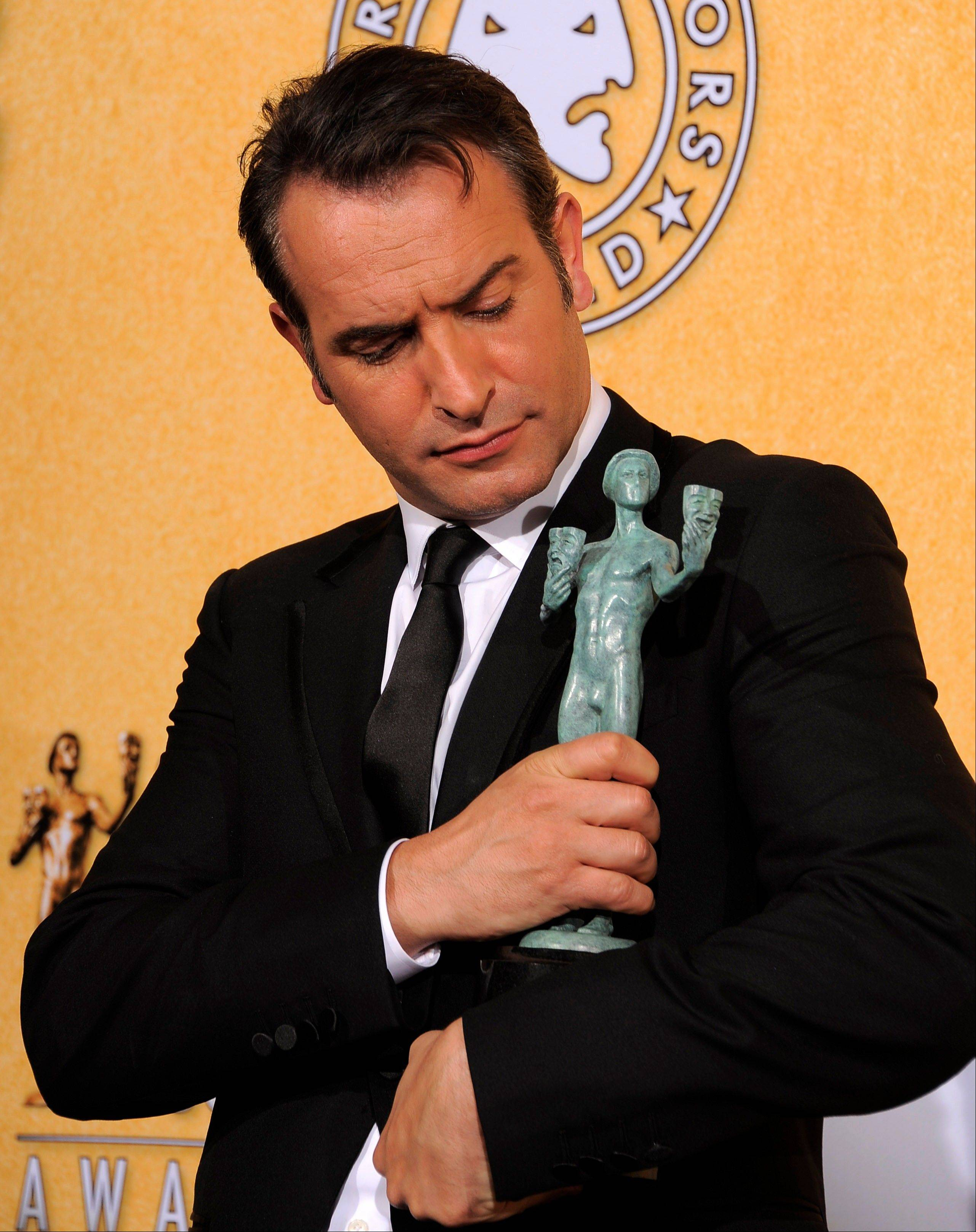 "ASSOCIATED PRESSJean Dujardin poses backstage with the award for outstanding performance by a male actor in a leading role for ""The Artist."""