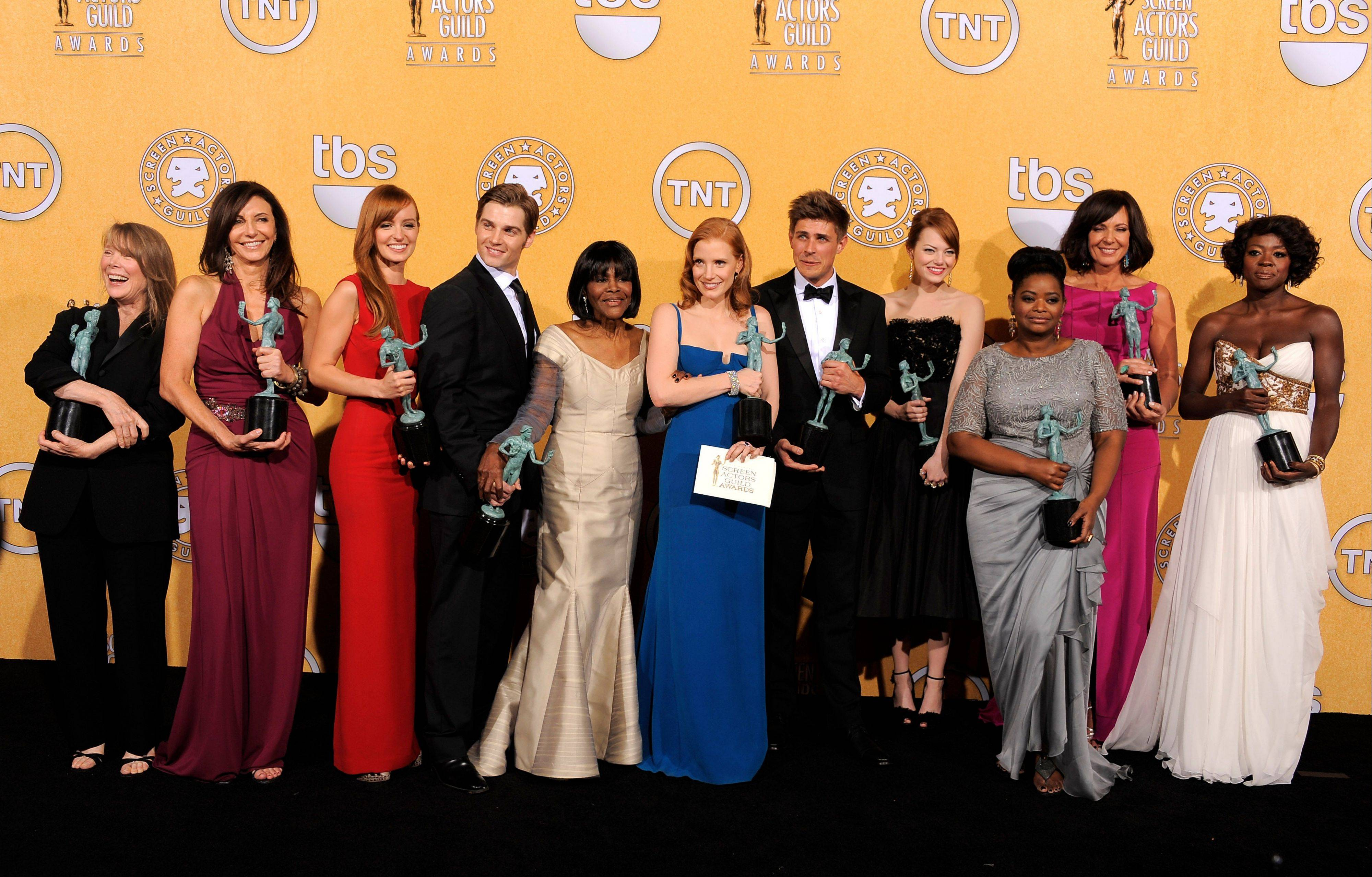 "ASSOCIATED PRESSCastmembers of ""The Help"" pose backstage with their awards for outstanding performance by a cast in a motion picture. From left, Sissy Spacek, Mary Steenburgen, Ahna O'Reilly, Mike Vogel, Cicely Tyson, Jessica Chastain, Chris Lowell, Emma Stone, Octavia Spencer, Allison Janney and Viola Davis."