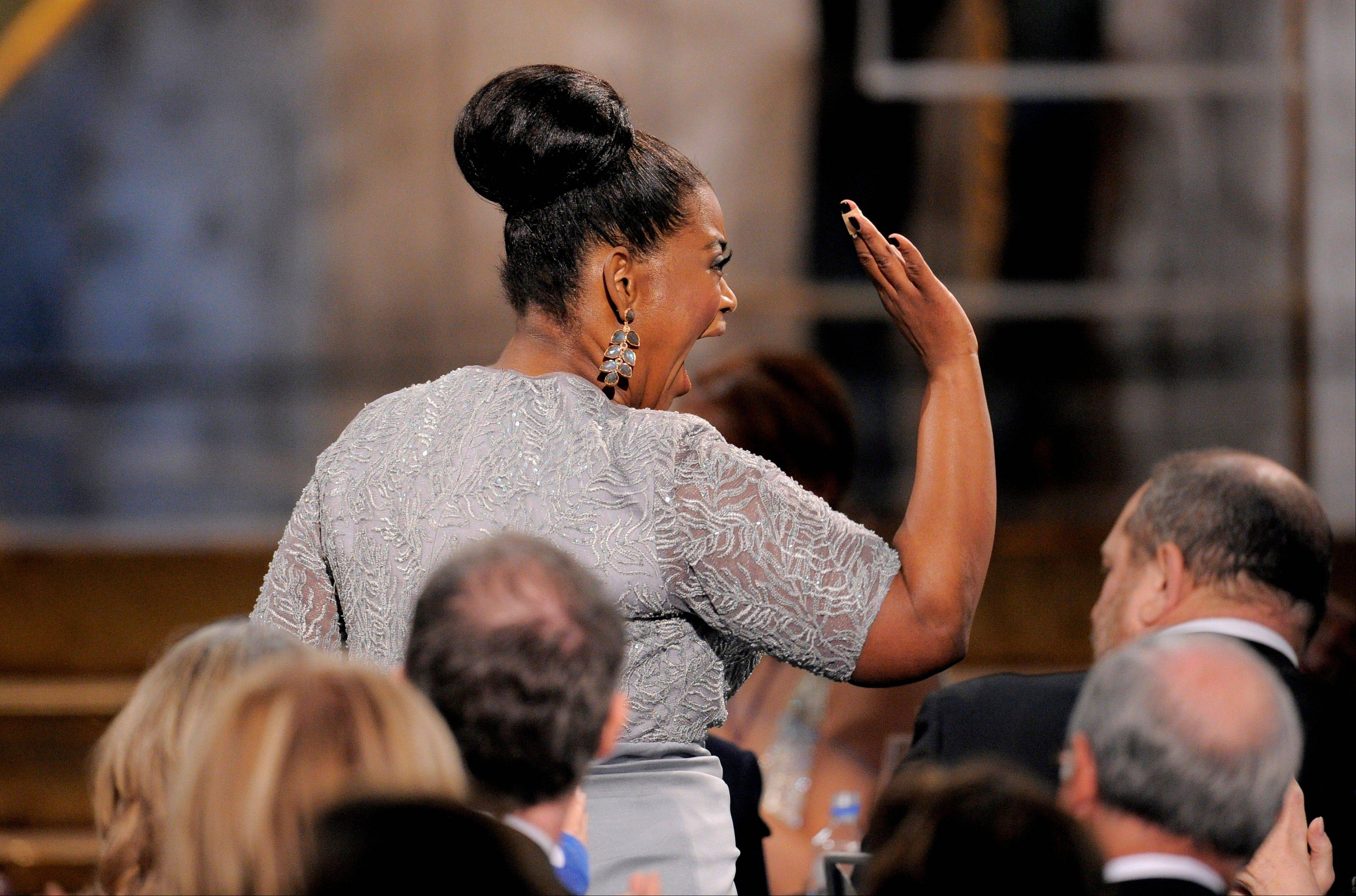 "ASSOCIATED PRESSOctavia Spencer celebrates on her way up to the stage to accept the award for outstanding performance by a female actor in a supporting role for ""The Help"" at the 18th Annual Screen Actors Guild Awards on Sunday in Los Angeles."