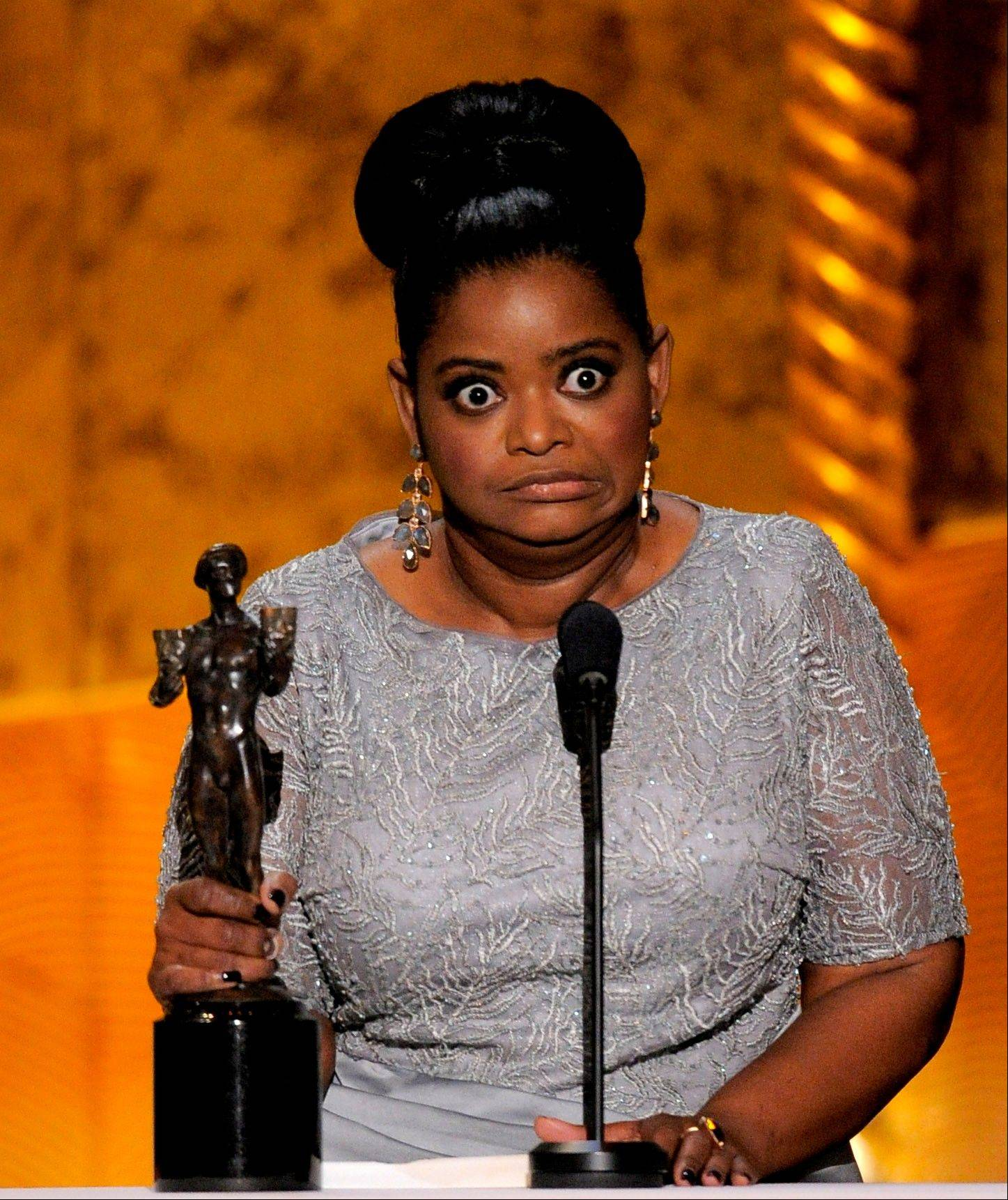 "ASSOCIATED PRESSOctavia Spencer accepts the award for outstanding performance by a female actor in a supporting role for ""The Help"" at the 18th Annual Screen Actors Guild Awards on Sunday in Los Angeles."