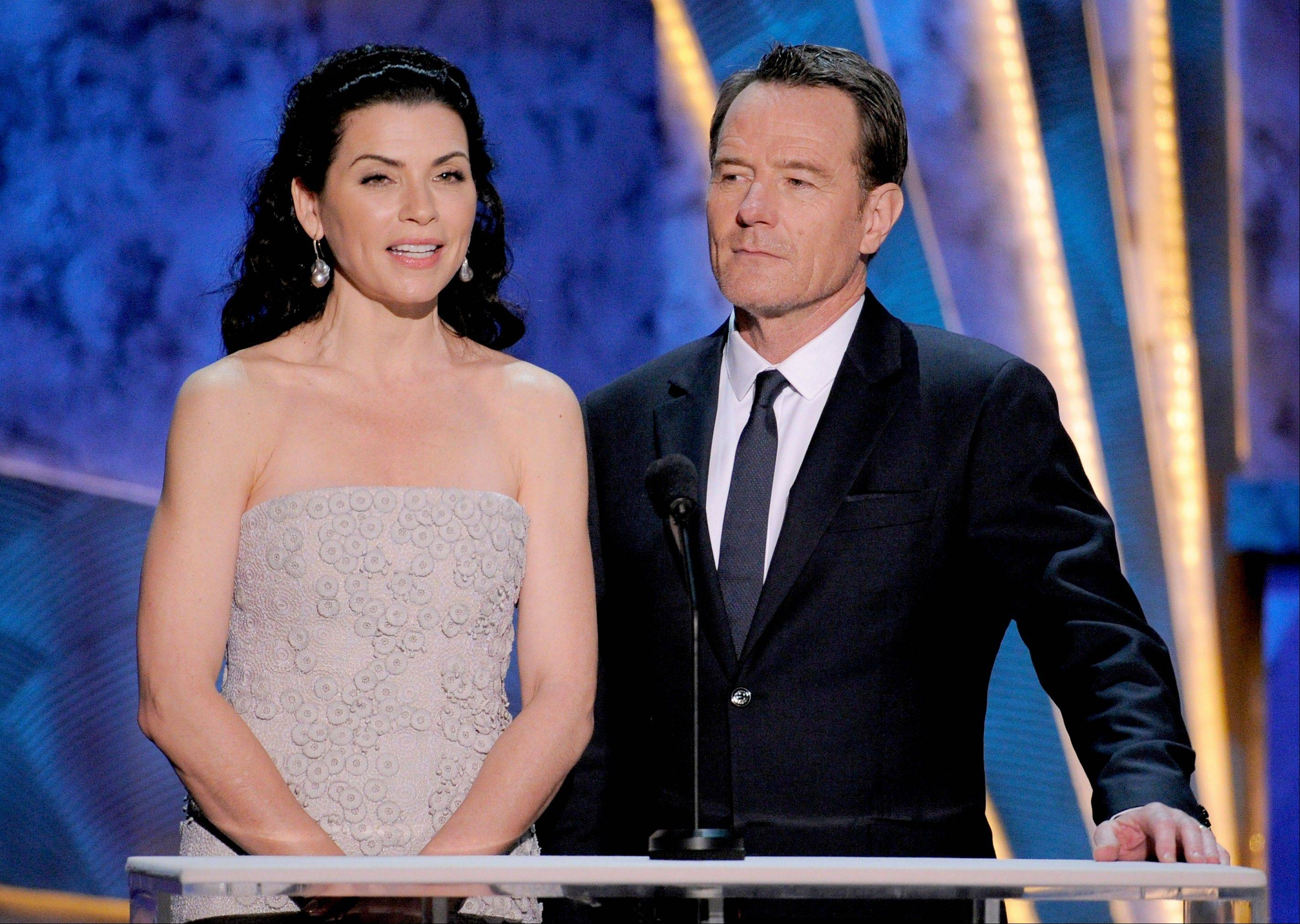 "ASSOCIATED PRESS""The Good Wife"" star Julianna Margulies and ""Breaking Bad"" star Bryan Cranston are seen onstage at the 18th Annual Screen Actors Guild Awards in Los Angeles."