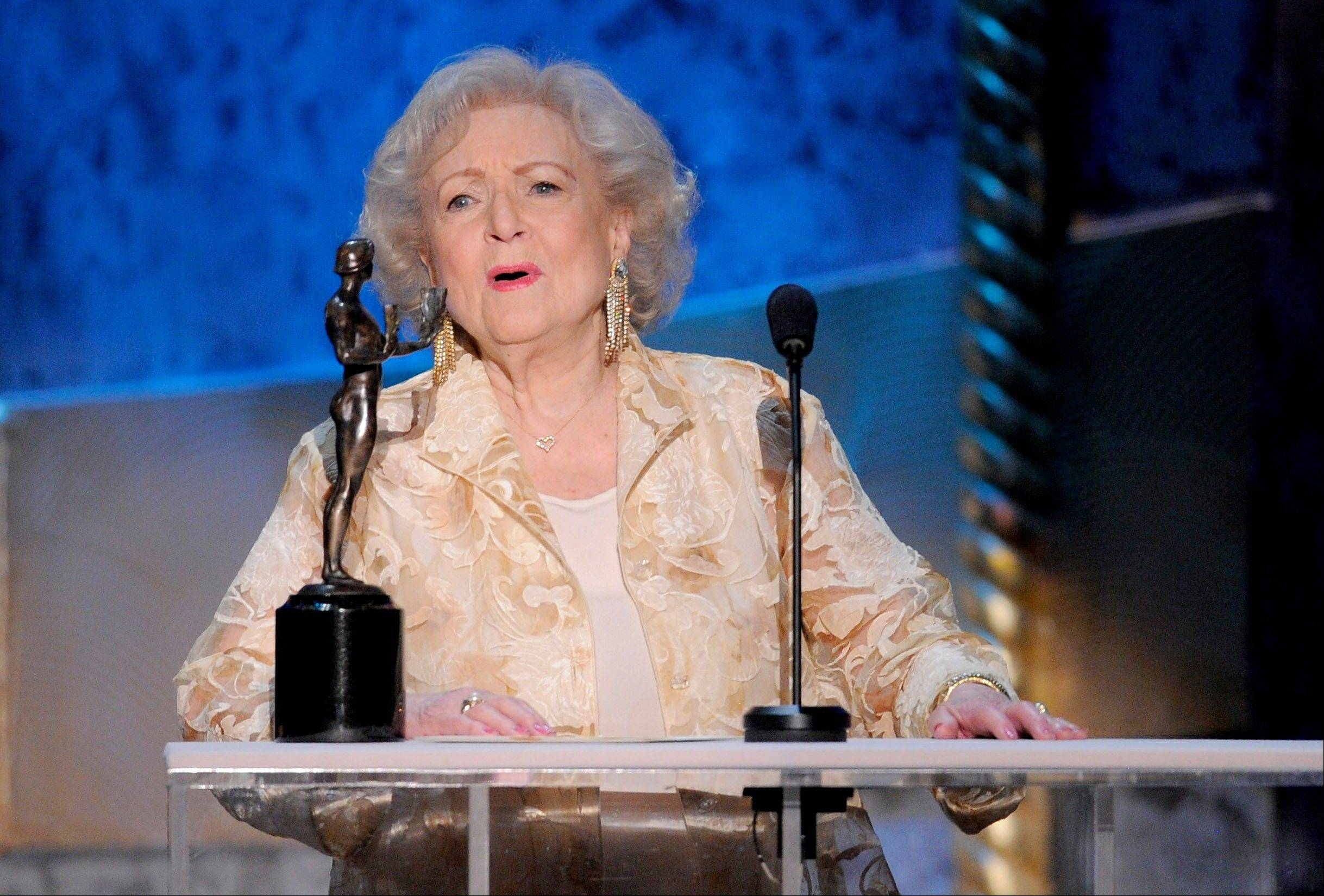 "ASSOCIATED PRESSBetty White accepts the award for outstanding performance by a female actor in a comedy series for ""Hot in Cleveland"" at the 18th Annual Screen Actors Guild Awards on Sunday Jan. 29, 2012 in Los Angeles."