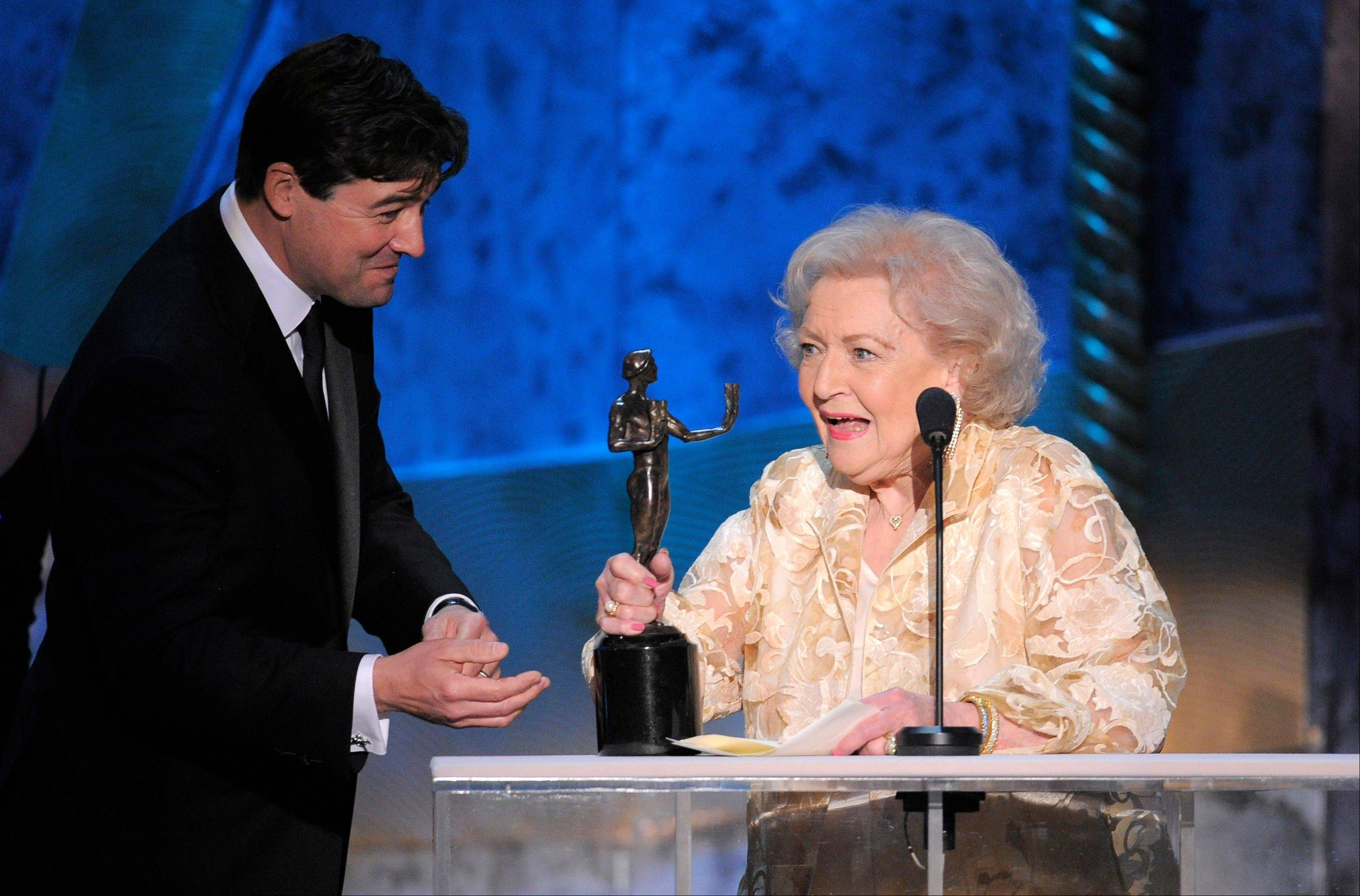 "ASSOCIATED PRESSBetty White accepts the award for outstanding performance by a female actor in a comedy series for ""Hot in Cleveland"" from ""Friday Night Lights"" star Kyle Chandler."