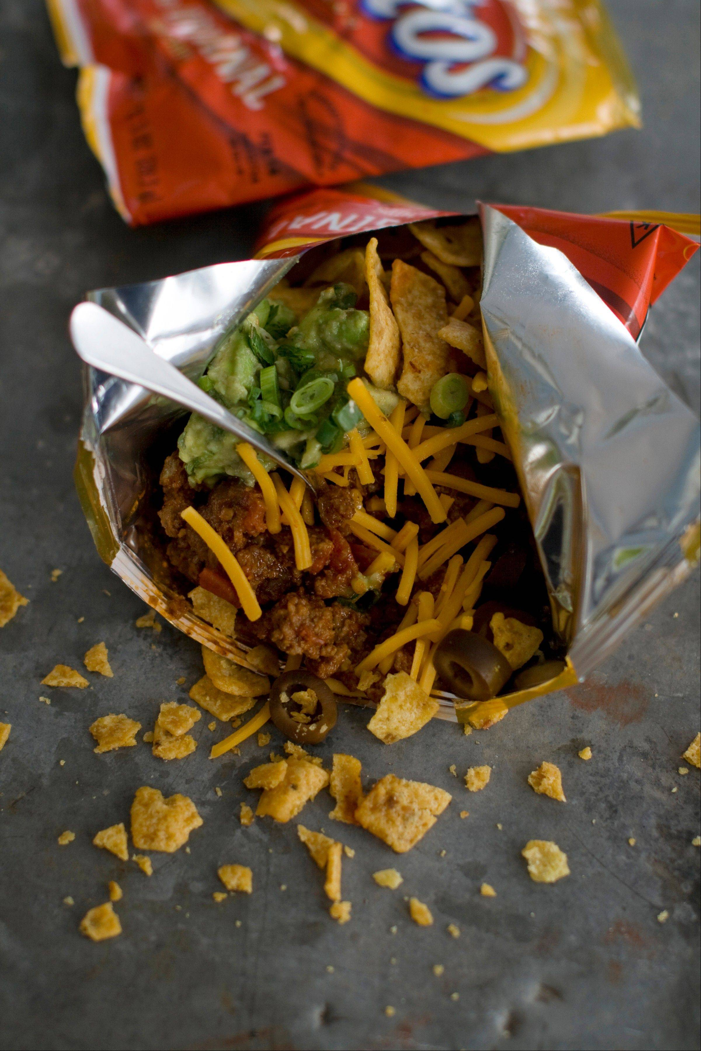 A walking taco is a variety of toppings dumped into a snack-size bag of Fritos and eaten right from the bag.