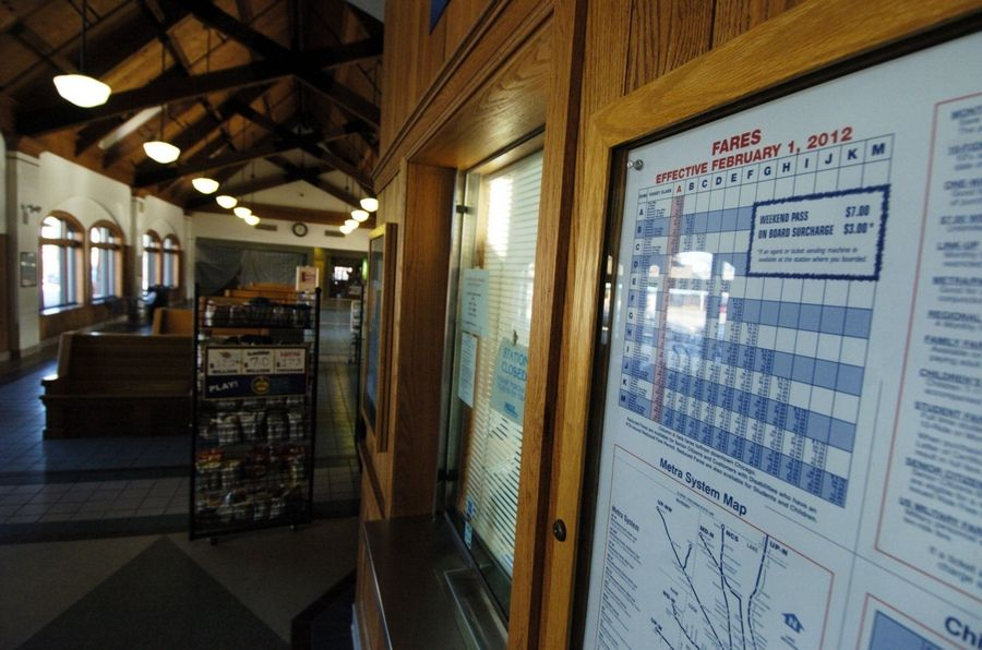 A poster with information about Metra fare increases coming Wednesday is on display outside the ticket window at the Arlington Heights station. Metra fares will spike this week by an average of 30 percent for 10-ride tickets and 29 percent for monthly passes.