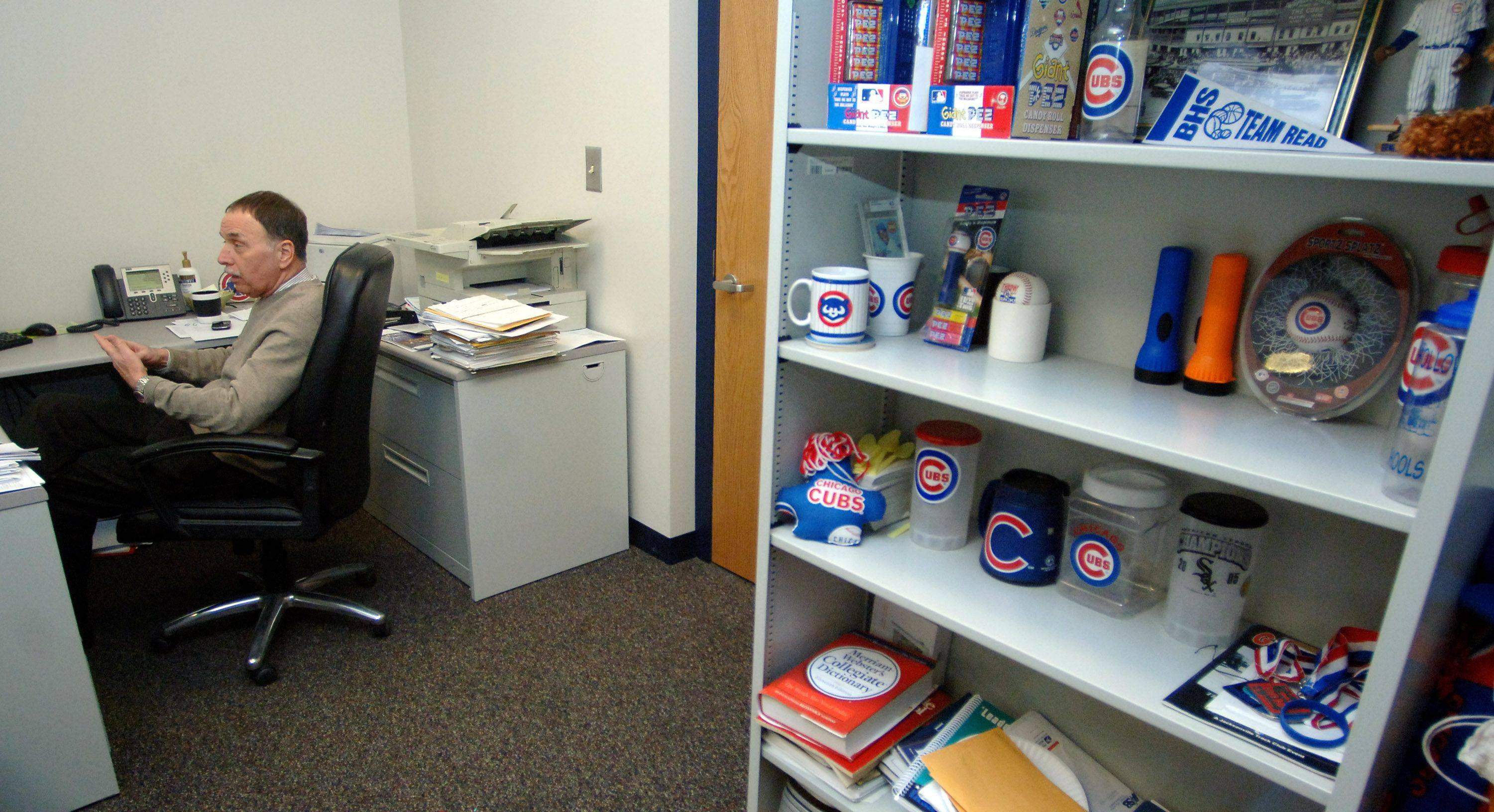 "Longtime Big Hollow Elementary District 38 superintendent Ronald Pazanin has a collection of Cubs items in his tiny Ingleside office. ""I don't need any more than this,"" Pazanin said of the small space."