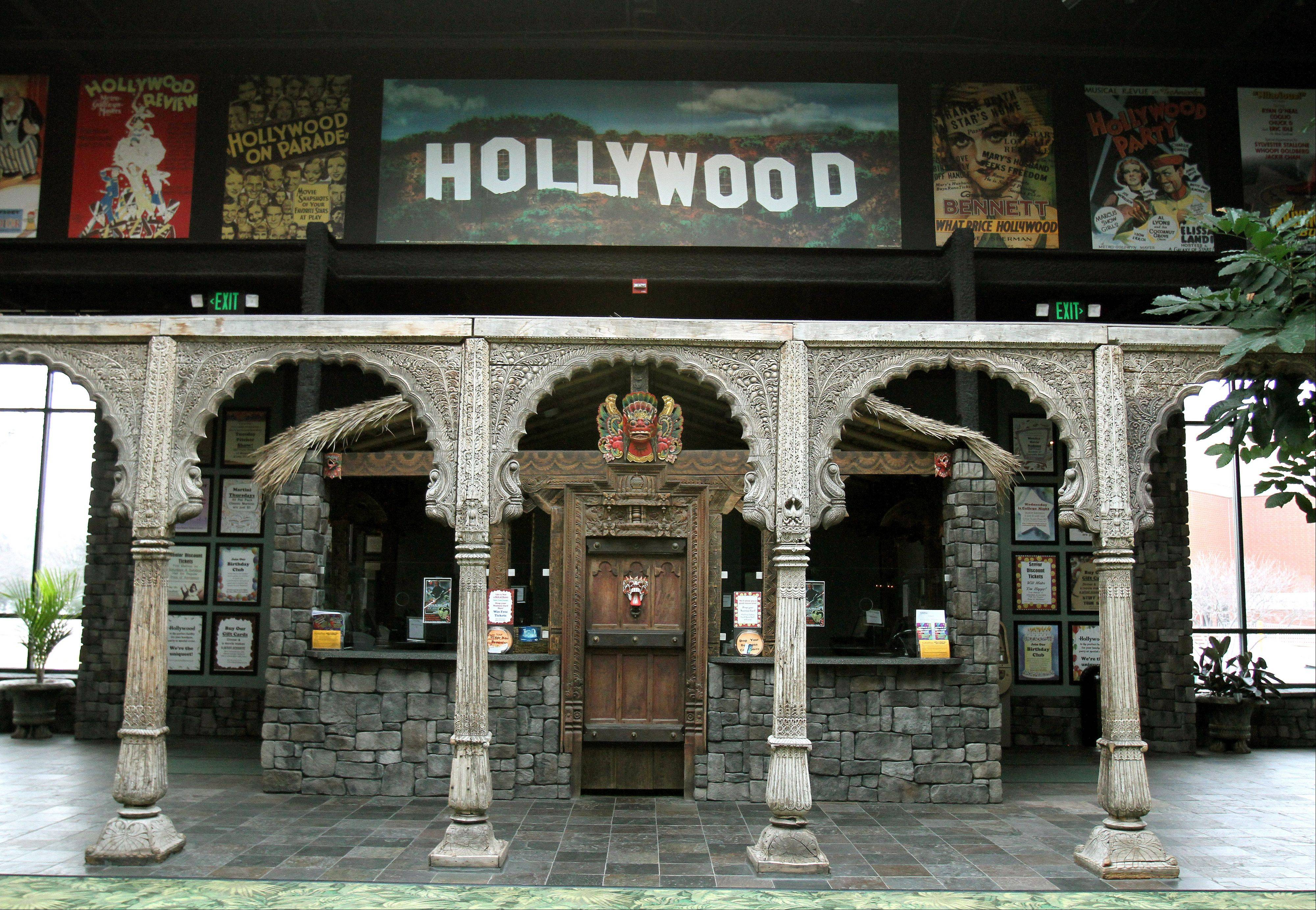 Doors from India, 200 year-old columns from Afghanistan and masks from Indonesia are part of the decor of the ticket office at Hollywood Palms Cinema in Naperville.