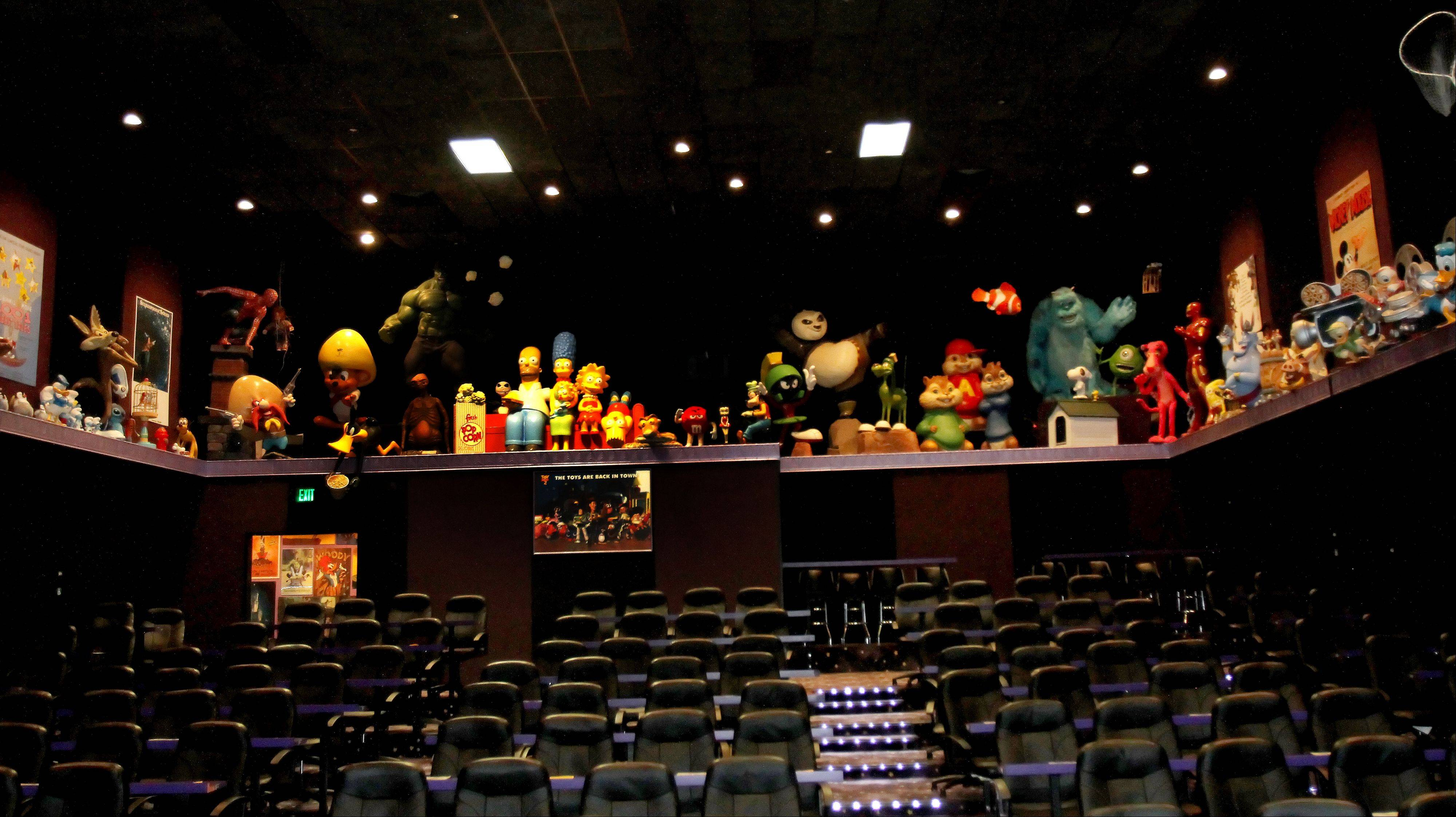 One theater is decorated with all sorts of cartoon characters at the Hollywood Palms Cinema in Naperville.