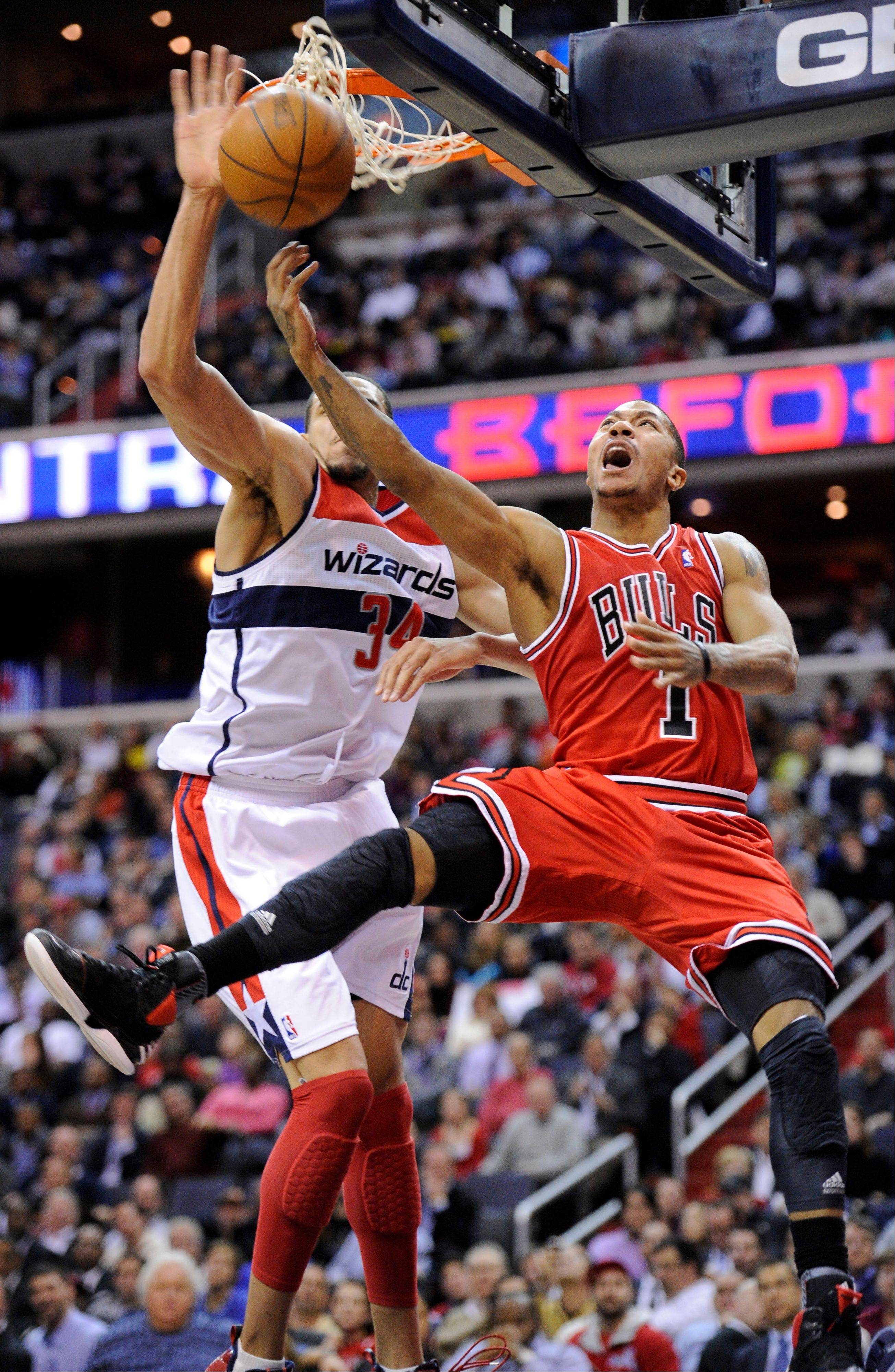 Chicago Bulls guard Derrick Rose (1) shoots a layup against Washington Wizards center JaVale McGee (34) during the first half of an NBA basketball game Monday in Washington.